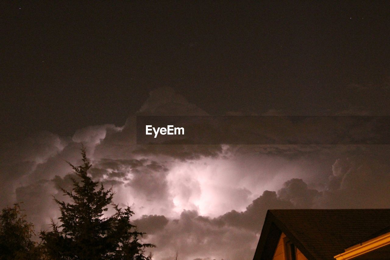 sky, weather, nature, beauty in nature, no people, low angle view, scenics, outdoors, cloud - sky, storm cloud, architecture, built structure, tree, thunderstorm, power in nature, night, lightning, building exterior, forked lightning