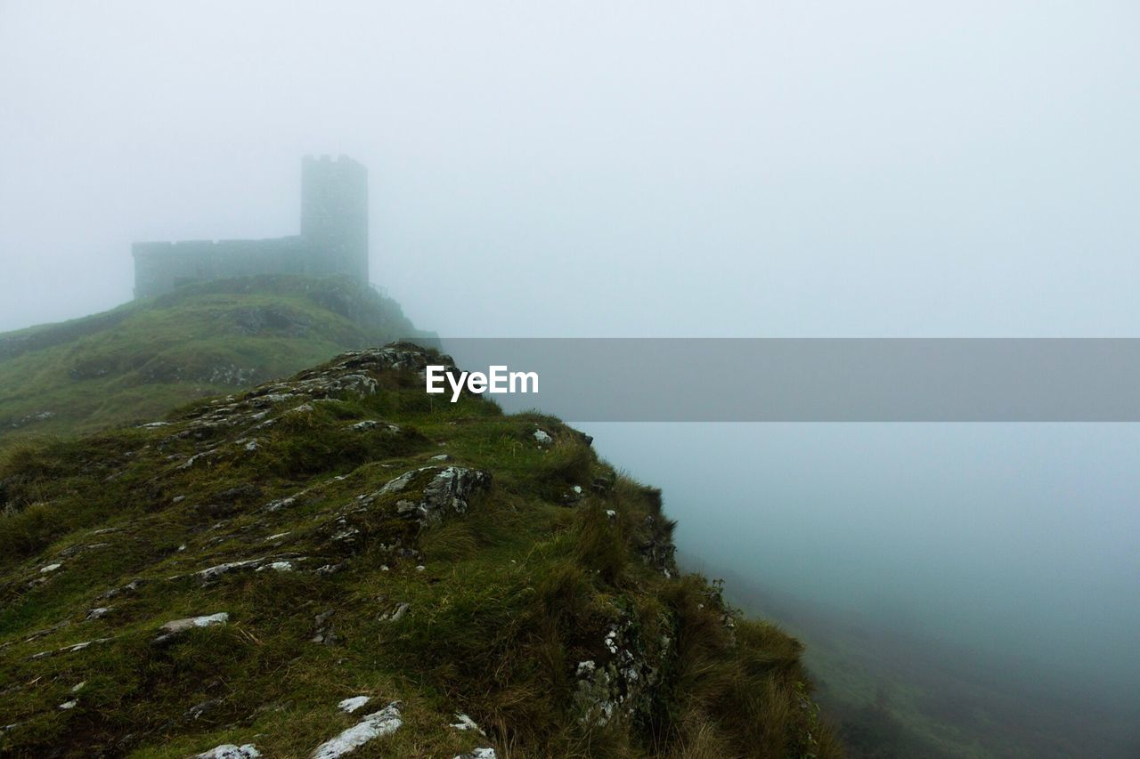 Scenic View Of Tree Mountains Against Sky During Foggy Weather