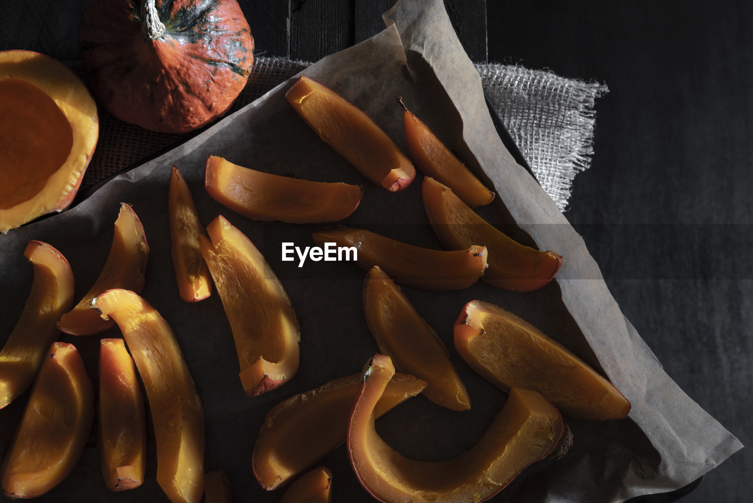 High angle view of pumpkin slices on table
