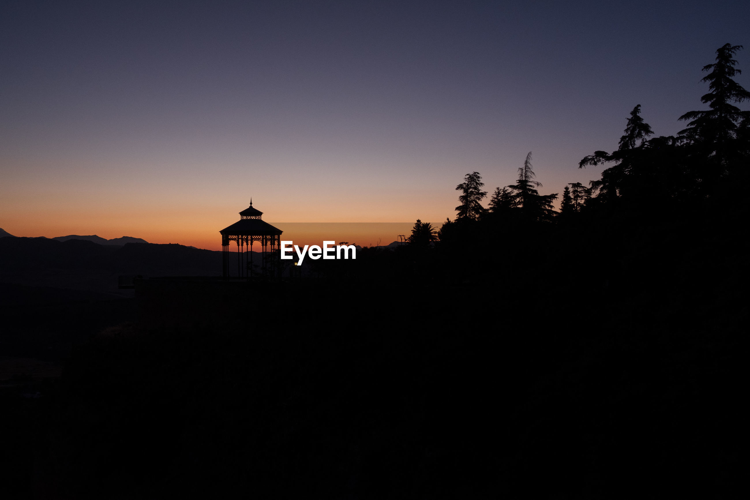 SILHOUETTE TEMPLE AGAINST CLEAR SKY AT SUNSET