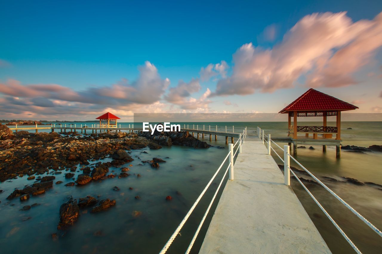 sky, cloud - sky, water, sea, beauty in nature, scenics - nature, architecture, built structure, beach, horizon over water, nature, sunset, land, tranquil scene, tranquility, horizon, the way forward, no people, idyllic, outdoors