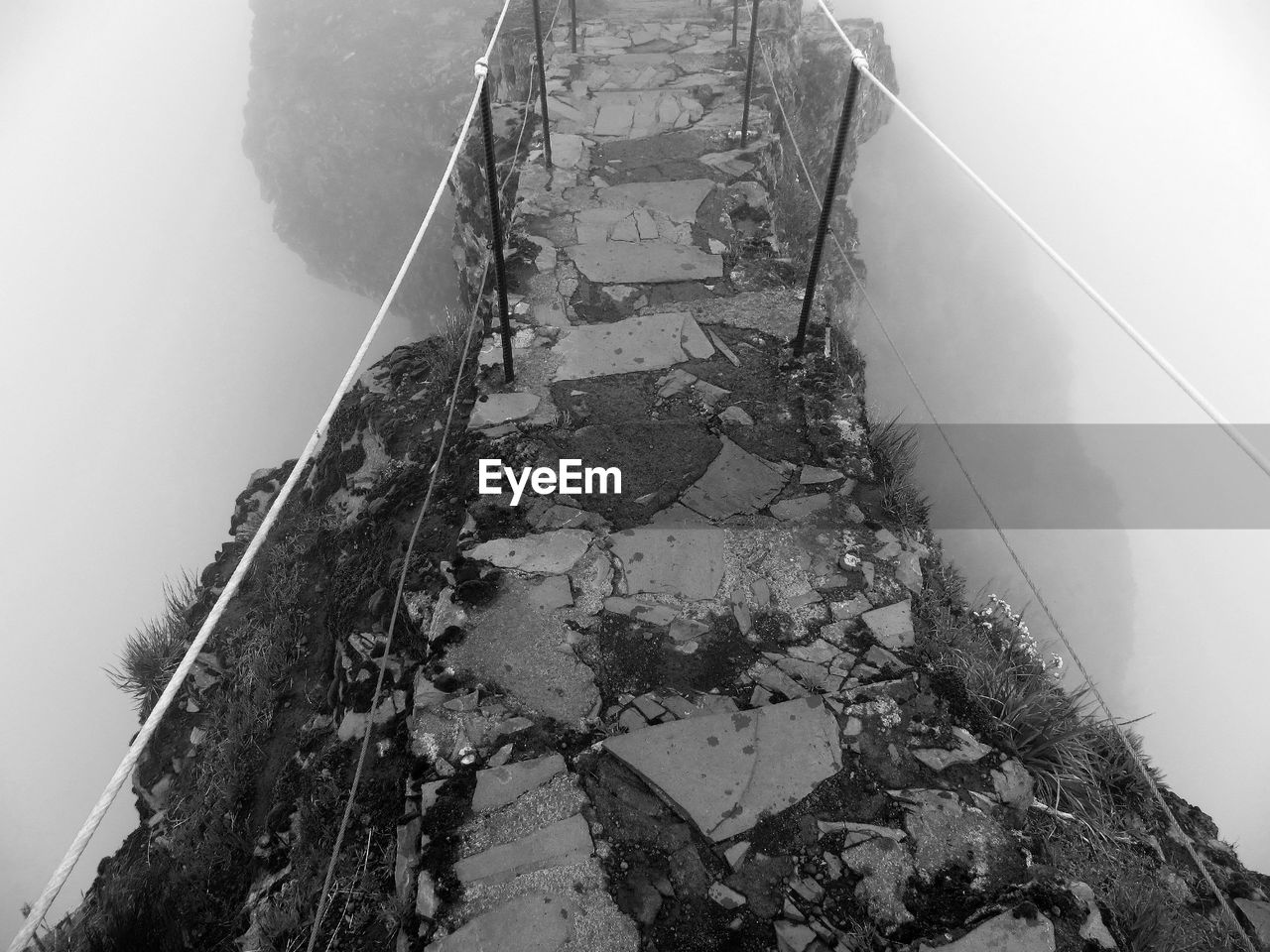 High angle view of damaged footbridge in foggy weather