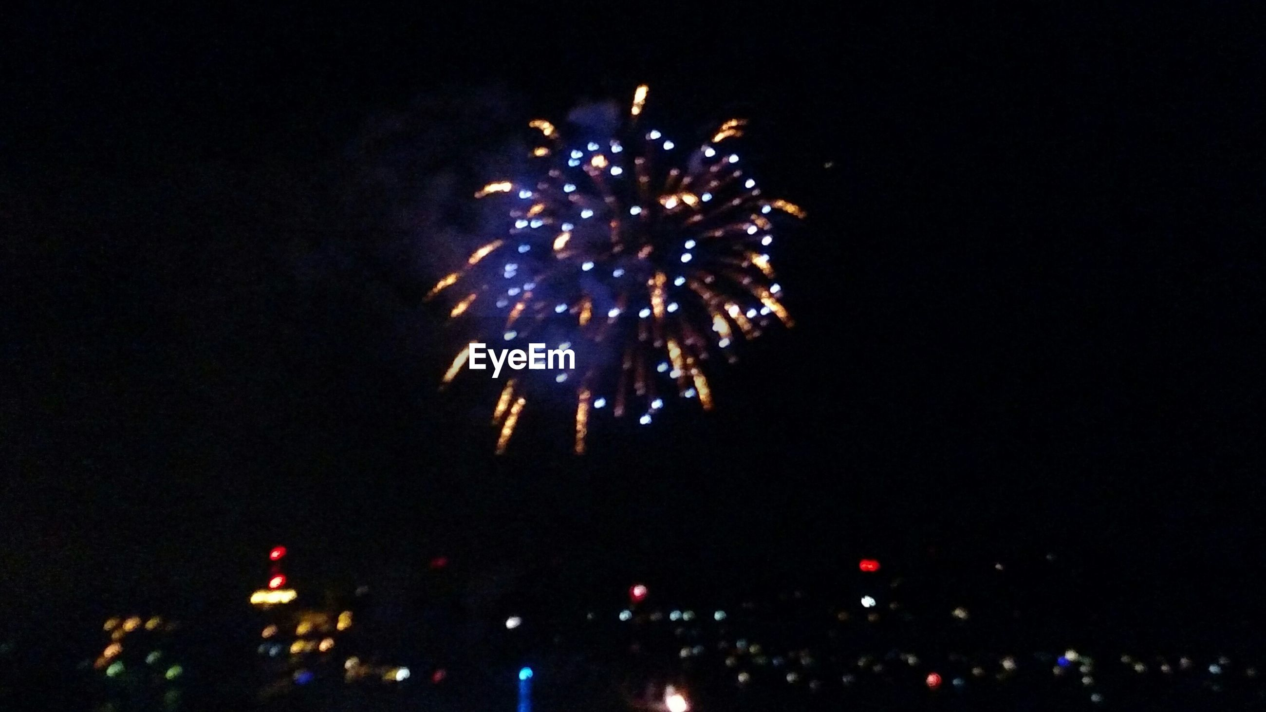 LOW ANGLE VIEW OF FIREWORKS DISPLAY