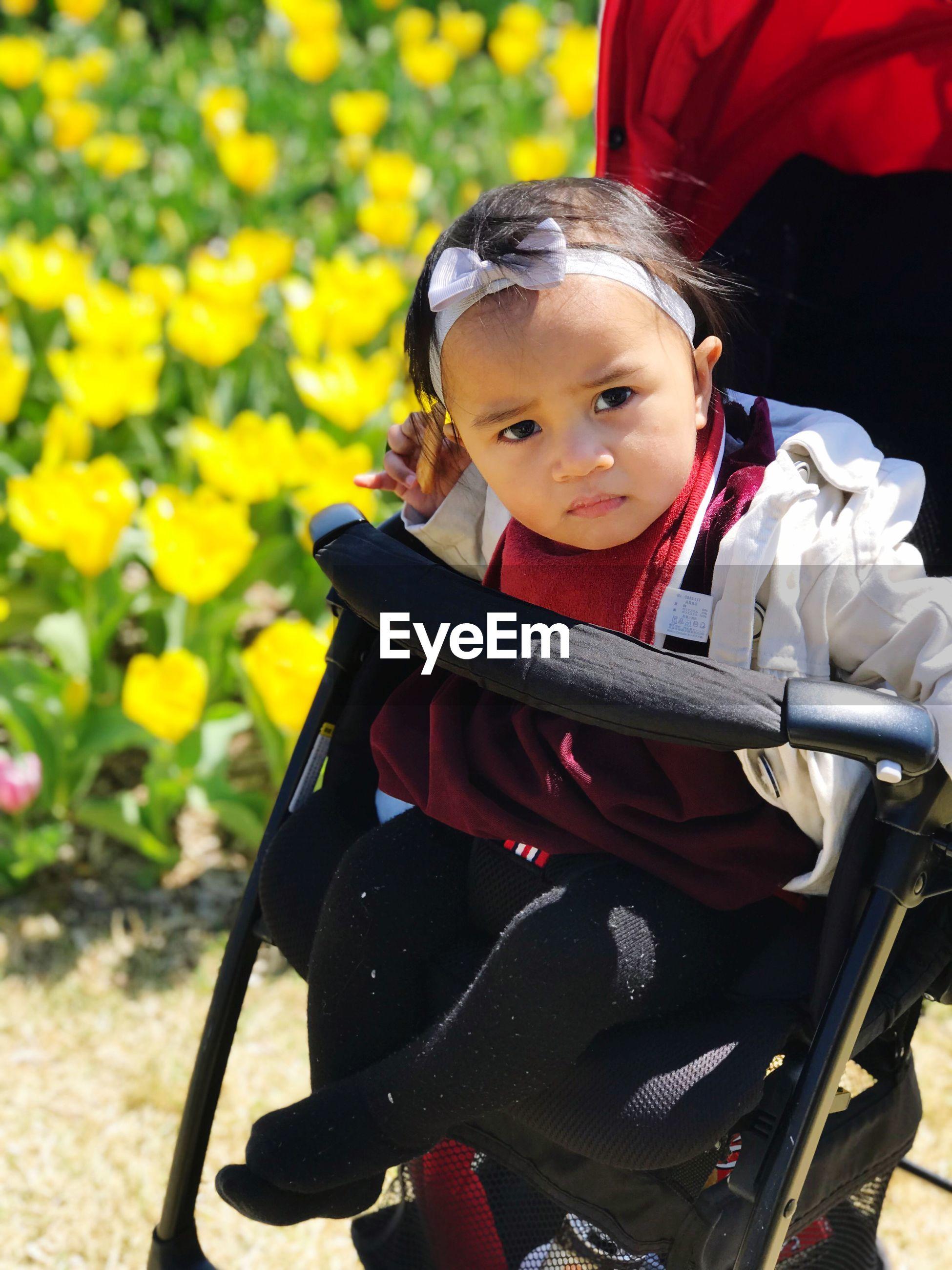 Portrait of smiling girl sitting in stroller