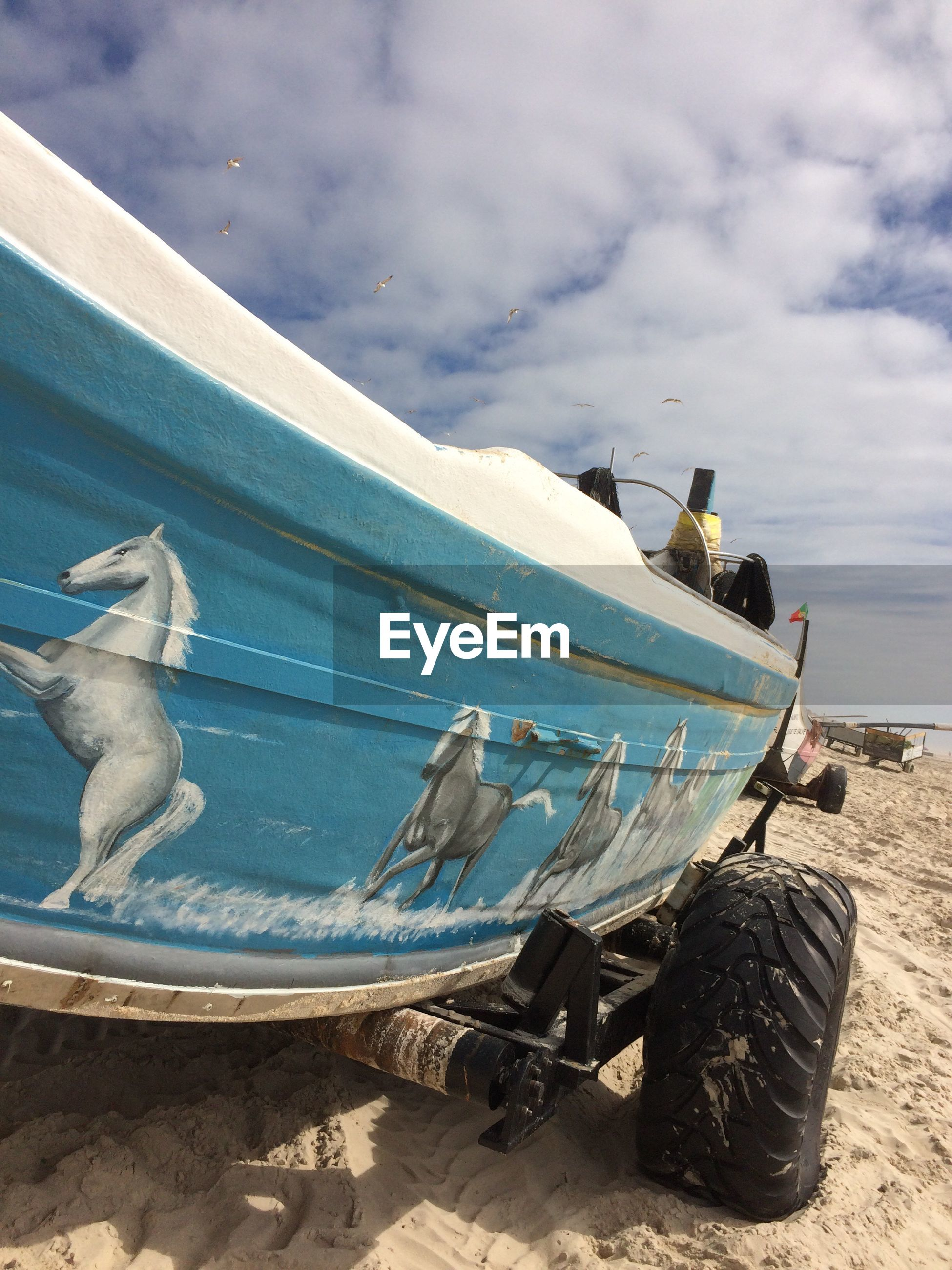 Boat on cart at sandy beach
