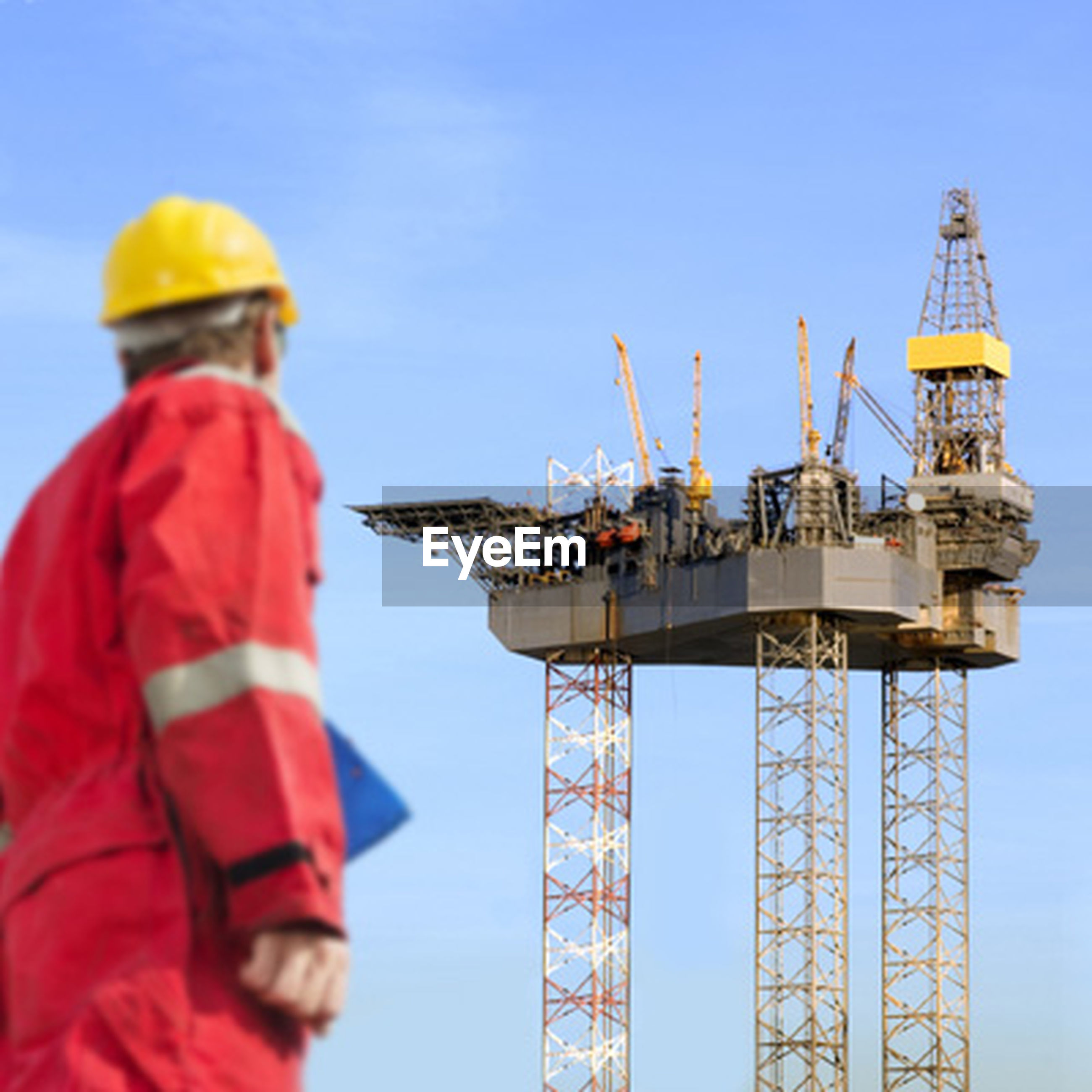 industry, engineer, hardhat, headwear, manual worker, industrial equipment, working, skill, oil industry, fuel and power generation, standing, helmet, sky, drill, occupation, offshore platform, drilling rig, outdoors, adults only, protective workwear, technology, people, day, one person, adult