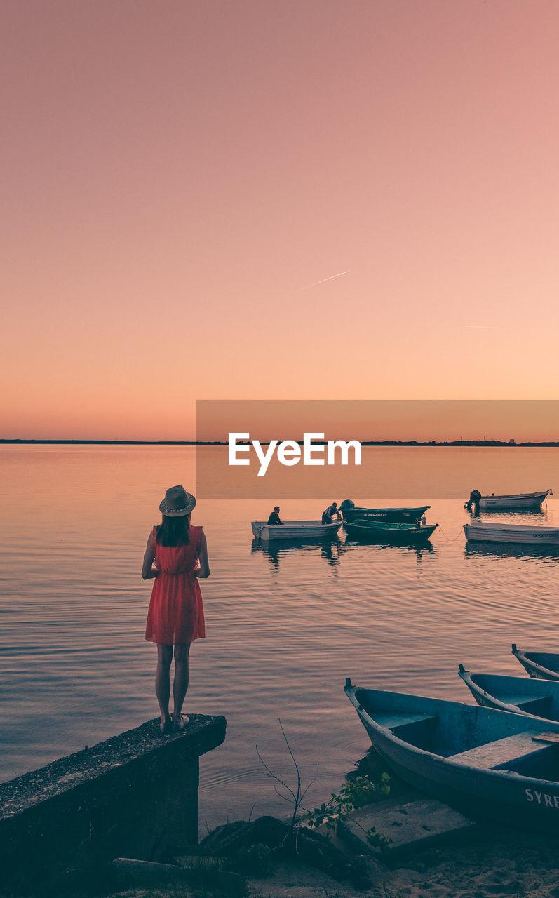 Woman On Lakeshore At Dusk