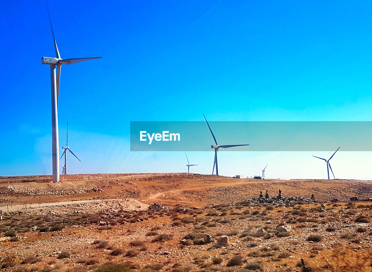 environmental conservation, environment, turbine, wind turbine, fuel and power generation, renewable energy, alternative energy, sky, wind power, landscape, technology, land, nature, field, no people, rural scene, day, blue, beauty in nature, scenics - nature, climate, arid climate, power in nature, power supply