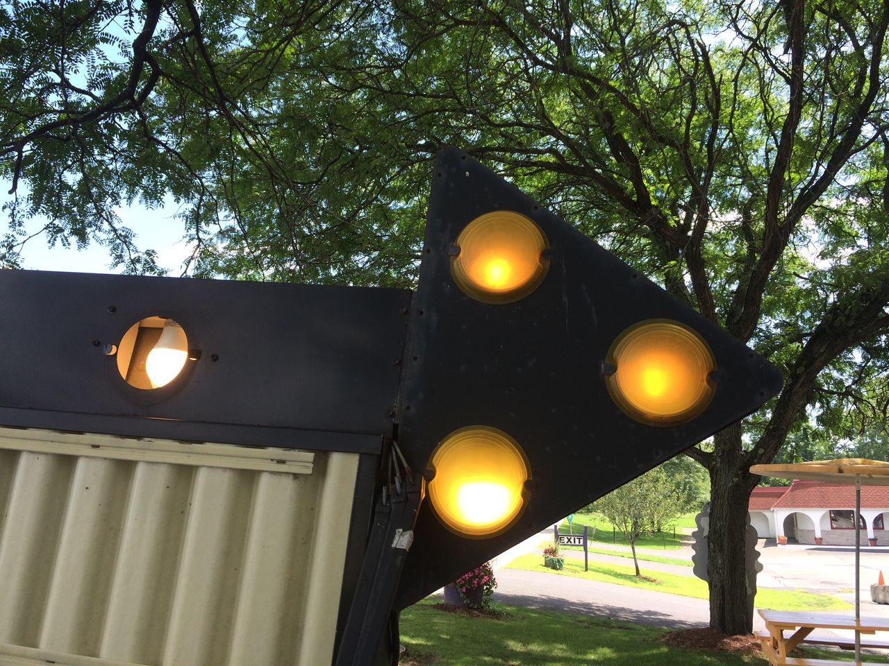 LOW ANGLE VIEW OF ILLUMINATED LIGHTING EQUIPMENT AGAINST SKY