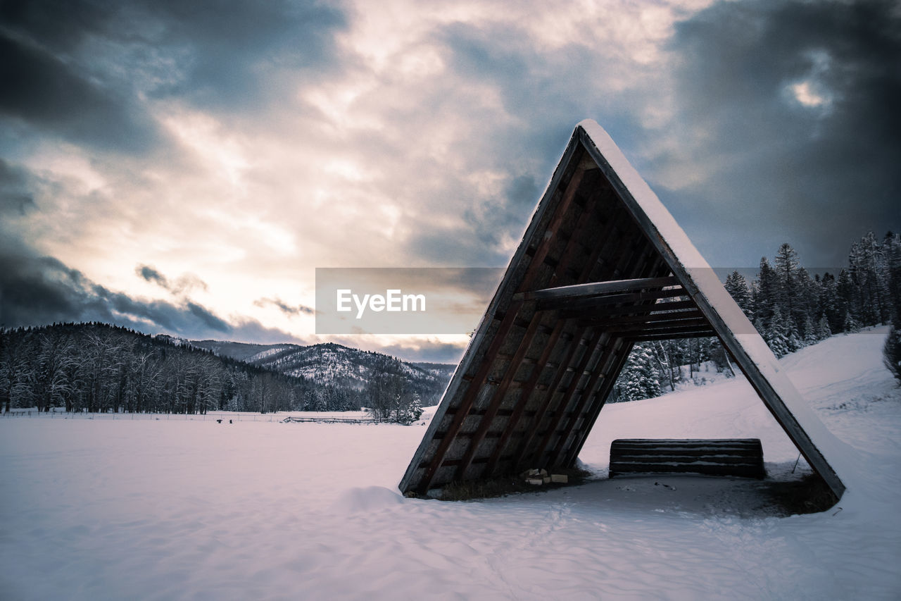 snow, winter, cold temperature, weather, nature, mountain, cloud - sky, sky, tranquility, no people, beauty in nature, scenics, outdoors, landscape, tree, sunset, day, frozen, built structure, architecture