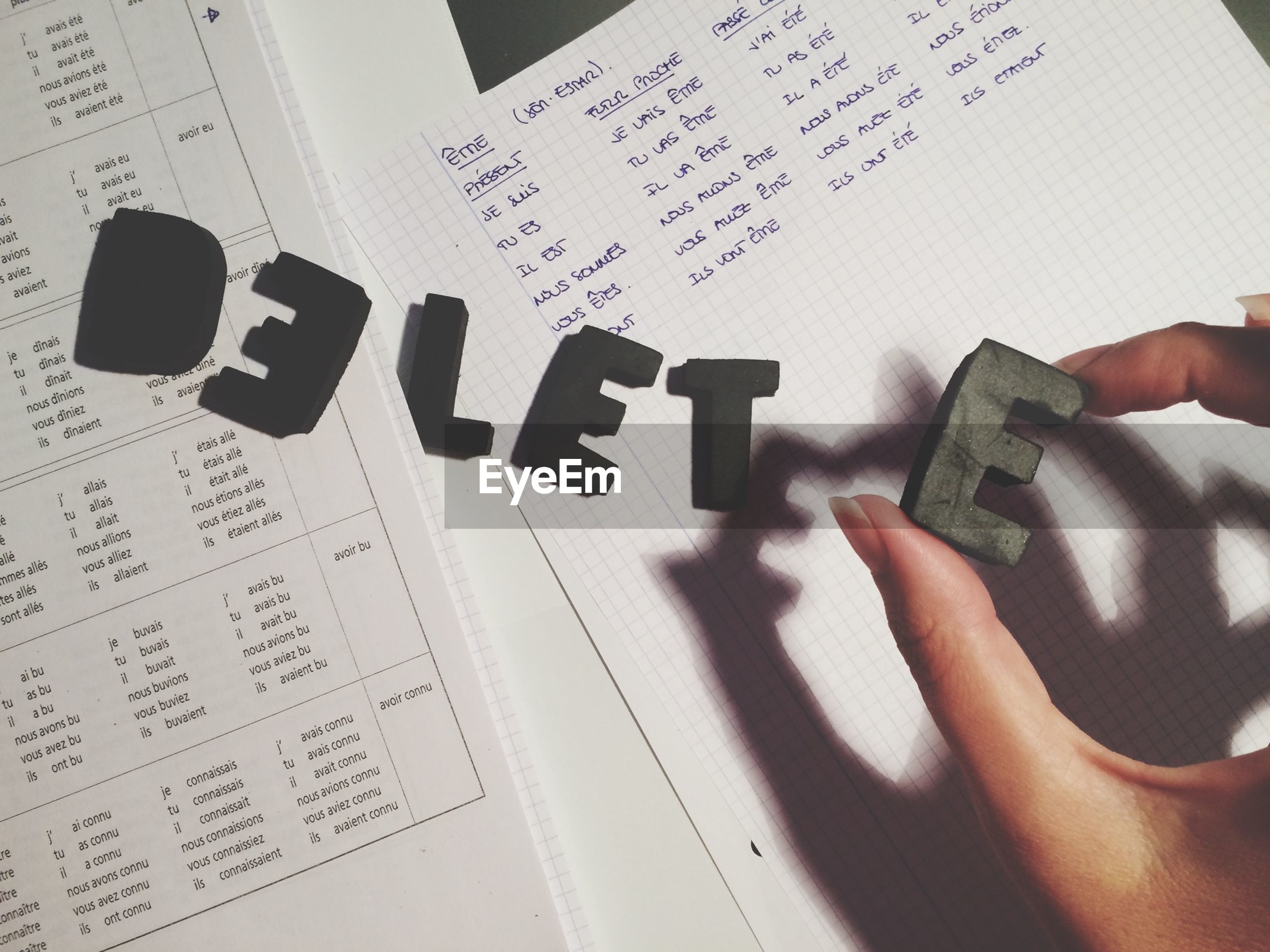 person, indoors, communication, text, part of, western script, cropped, human finger, paper, wireless technology, book, education, holding, close-up, technology, handwriting, writing