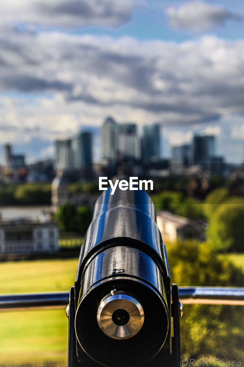 building exterior, architecture, built structure, focus on foreground, sky, day, city, metal, nature, binoculars, cloud - sky, no people, coin operated, outdoors, coin-operated binoculars, close-up, surveillance, building, railing, optical instrument, silver colored, steel, hand-held telescope, alloy