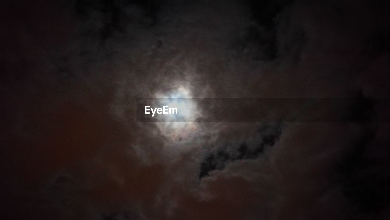 moon, low angle view, beauty in nature, nature, sky, scenics, night, no people, cloud - sky, tranquility, sky only, tranquil scene, outdoors, astronomy, backgrounds, space