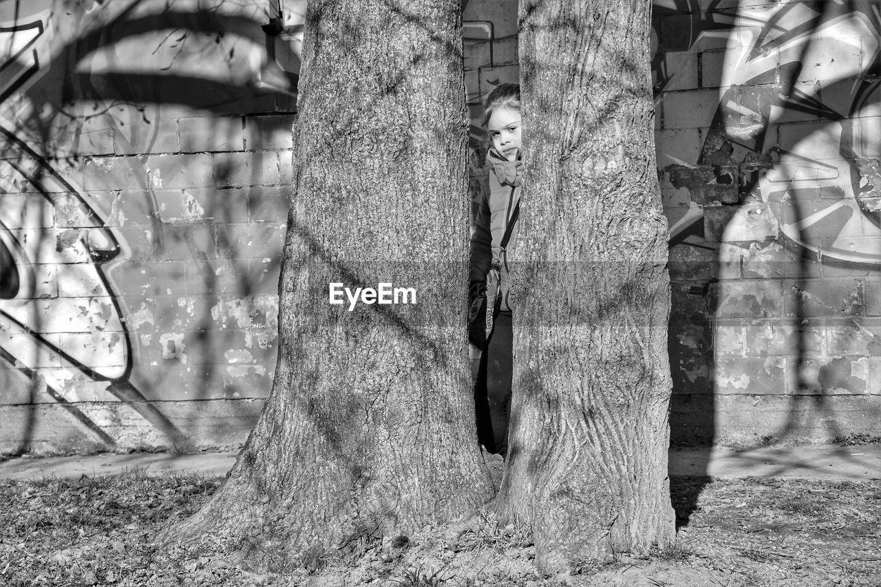 tree, plant, day, women, nature, real people, adult, tree trunk, trunk, men, outdoors, standing, architecture, people, two people, togetherness, land, growth, built structure, lifestyles, digital composite