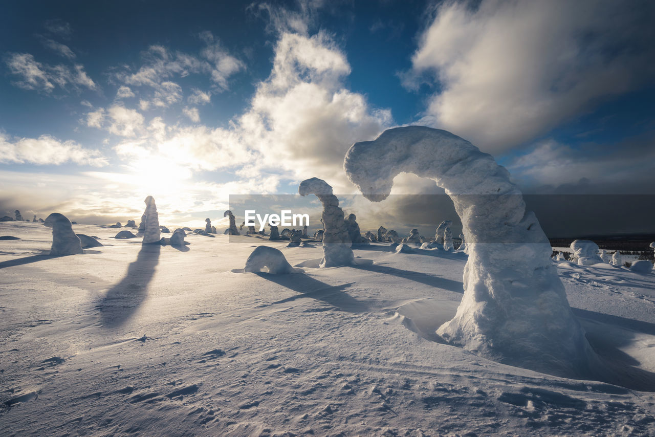 cloud - sky, sky, winter, cold temperature, snow, nature, beauty in nature, tranquil scene, scenics - nature, tranquility, sunlight, environment, non-urban scene, no people, landscape, land, frozen, day, field, outdoors, snowcapped mountain