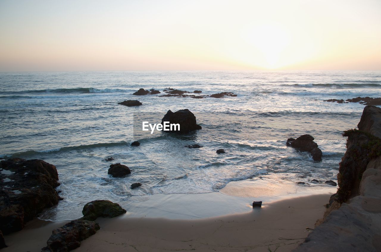 sea, rock, water, sky, rock - object, solid, scenics - nature, land, horizon over water, horizon, beach, beauty in nature, sunset, motion, nature, wave, tranquility, tranquil scene, no people