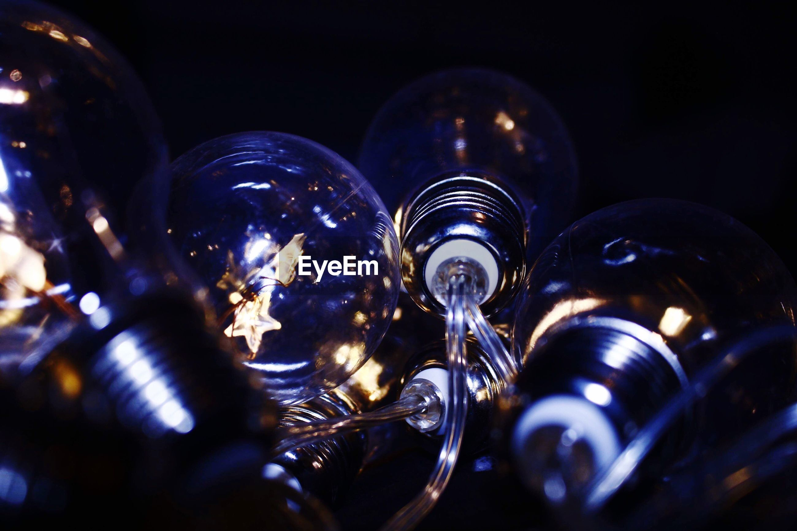 Close-up of illuminated light bulb in darkroom