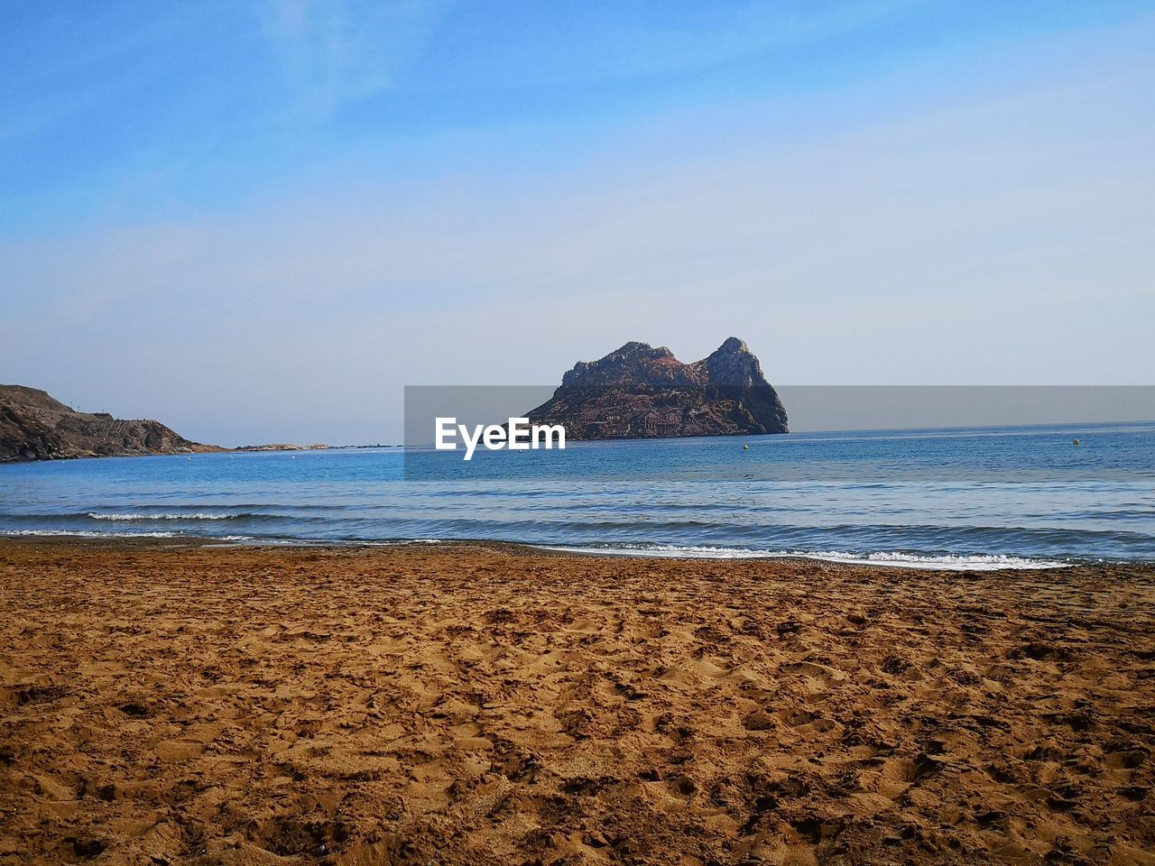 sea, sky, land, beach, water, scenics - nature, beauty in nature, tranquility, tranquil scene, no people, rock, horizon over water, blue, sand, nature, horizon, rock - object, rock formation, non-urban scene, outdoors, stack rock