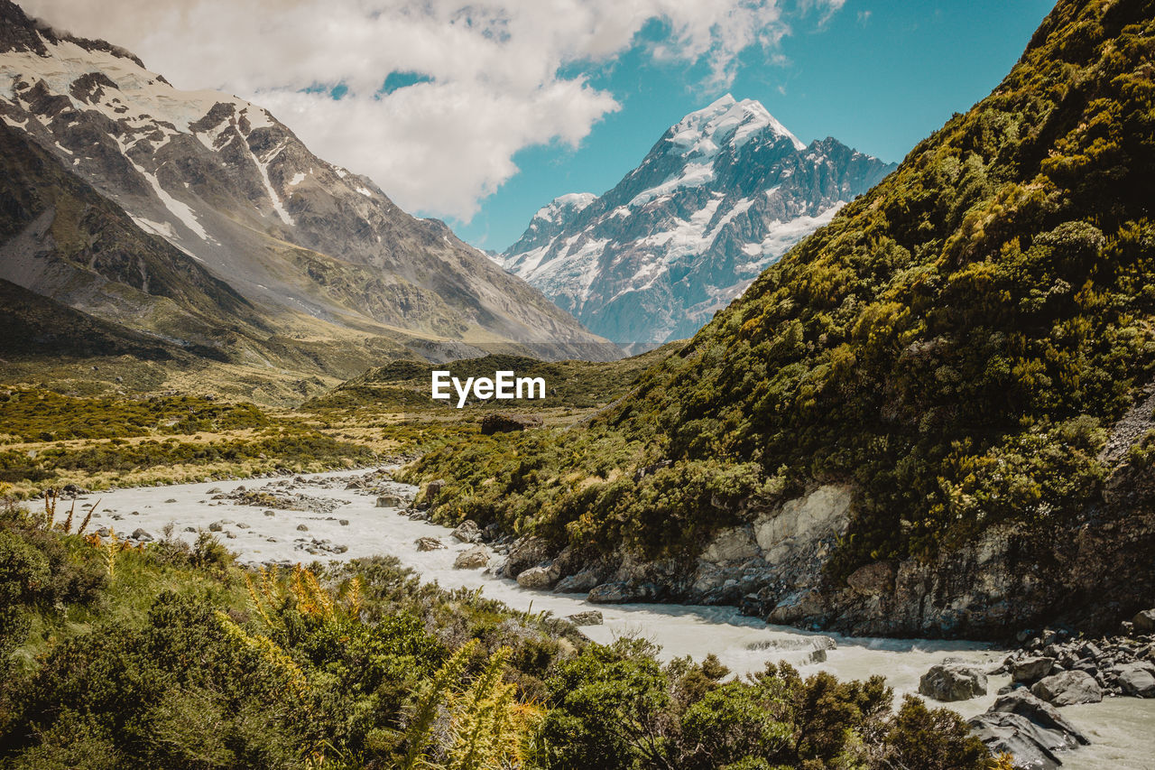 mountain, scenics - nature, beauty in nature, sky, water, tranquil scene, tranquility, nature, environment, cloud - sky, mountain range, non-urban scene, landscape, no people, snow, cold temperature, day, rock, flowing water, snowcapped mountain, stream - flowing water, mountain peak