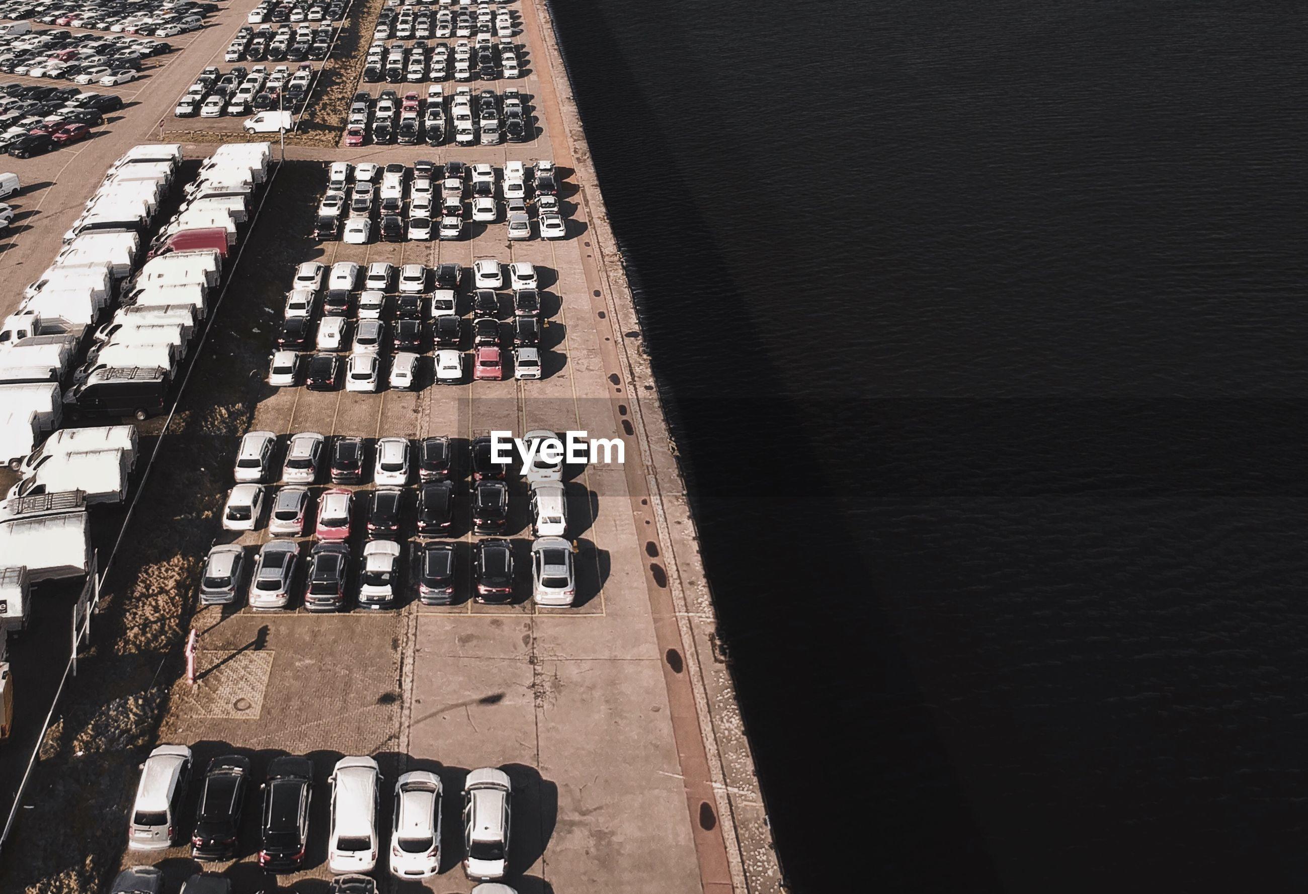 High angle view of cars parked at harbor