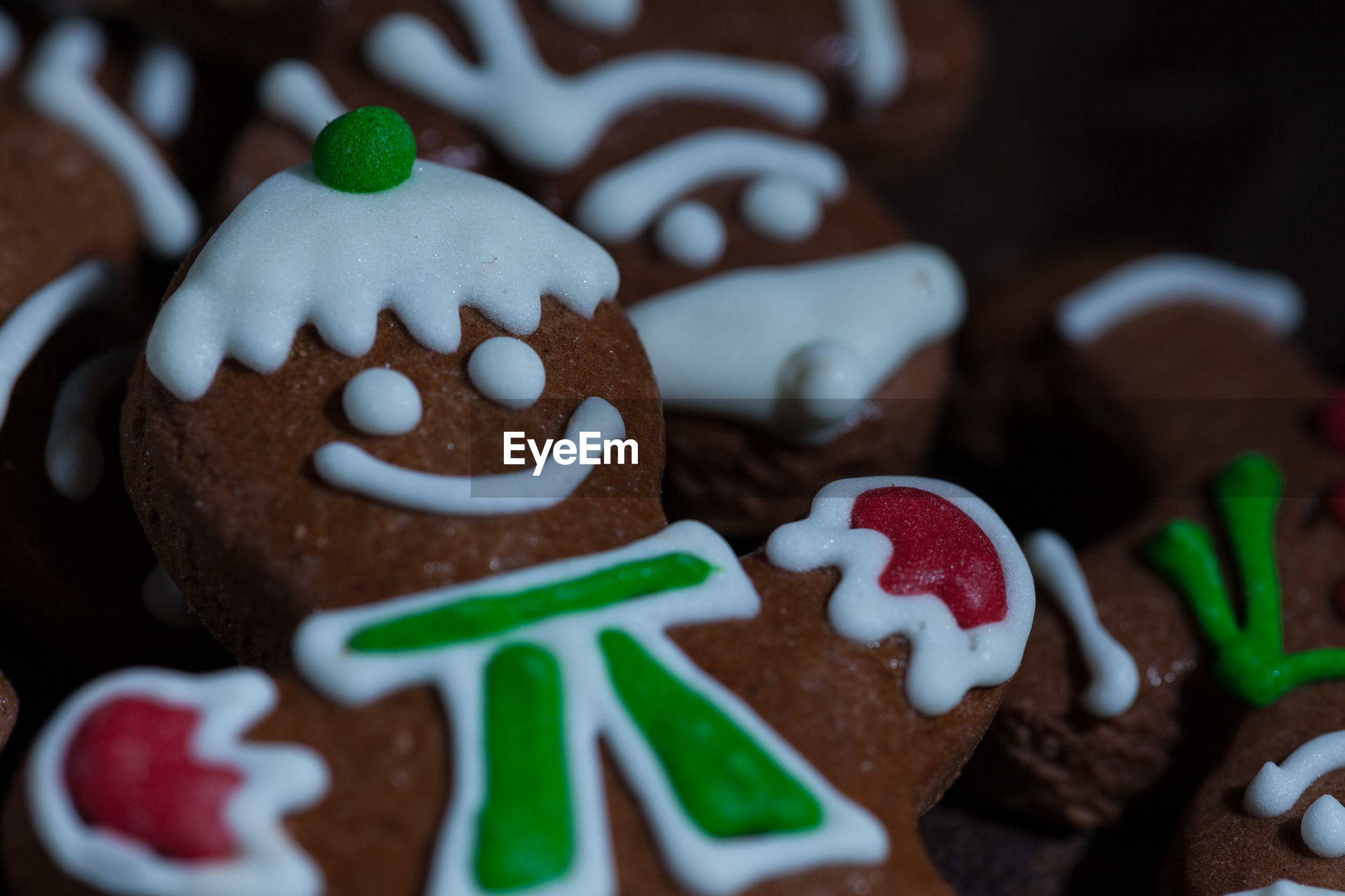 CLOSE-UP OF COOKIES ON TABLE AT CHRISTMAS TREE