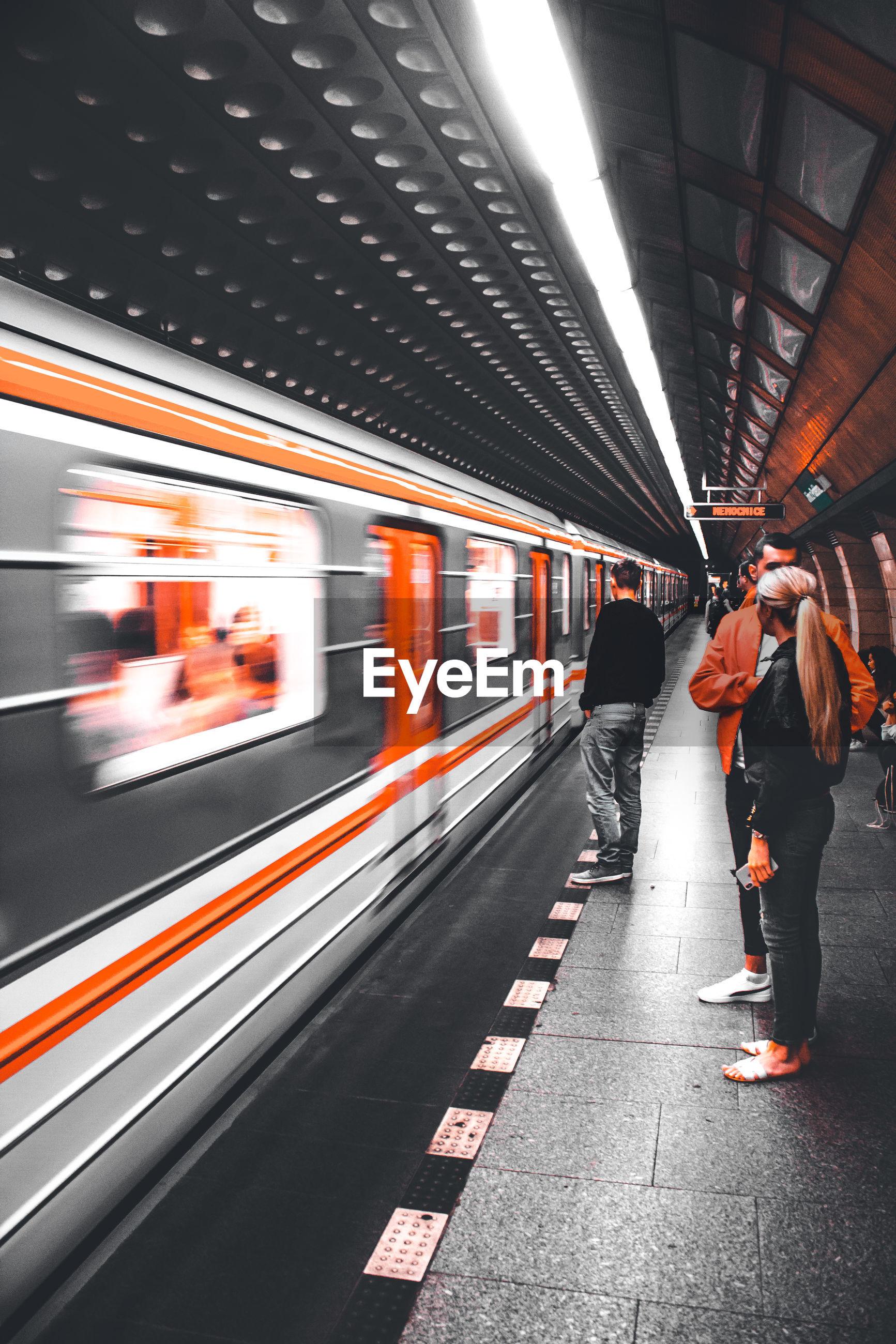 Blurred motion of train at underground metro station