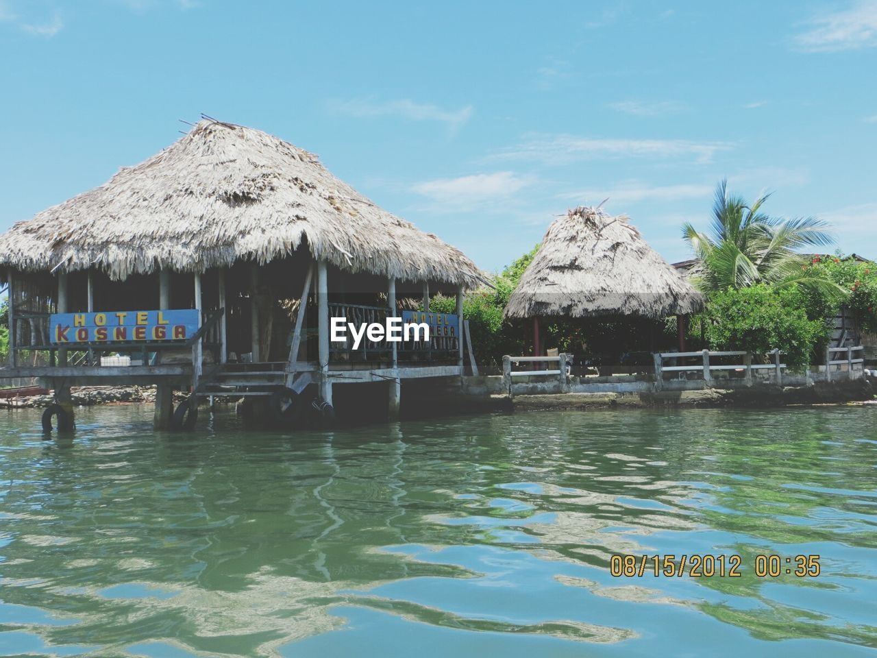 thatched roof, water, waterfront, stilt house, outdoors, day, nature, built structure, architecture, tranquility, no people, scenics, beauty in nature, building exterior, sky