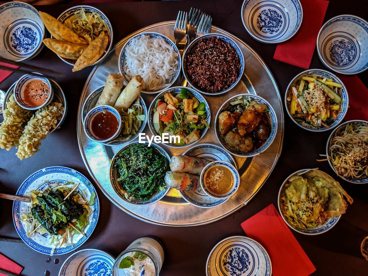 food and drink, table, food, bowl, choice, freshness, high angle view, variation, indoors, ready-to-eat, healthy eating, wellbeing, no people, still life, plate, serving size, meal, large group of objects, directly above, vegetable, garnish, chinese food