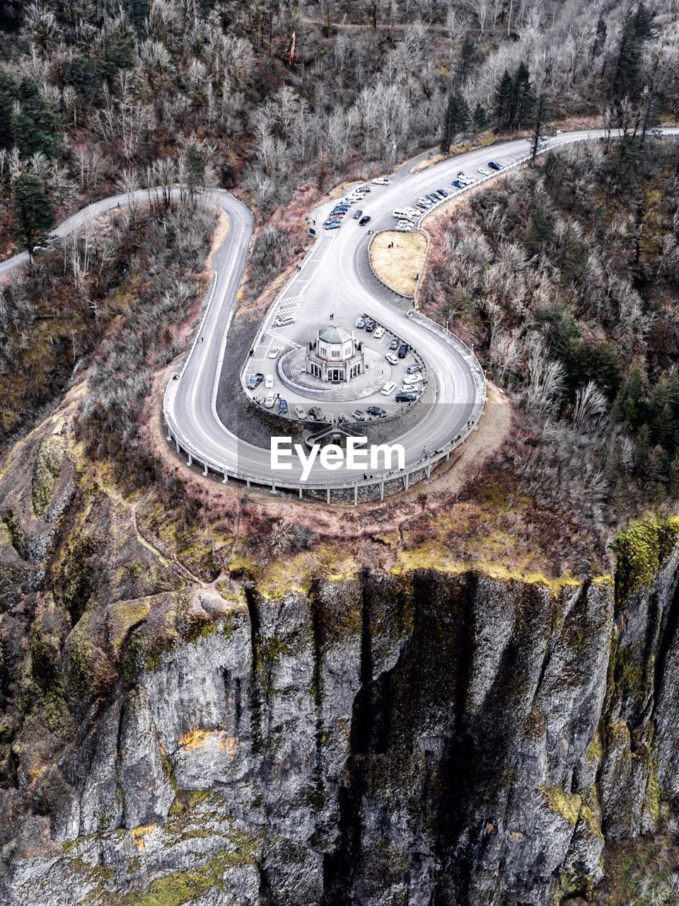 Aerial View Of Cars Surrounding Building On Cliff