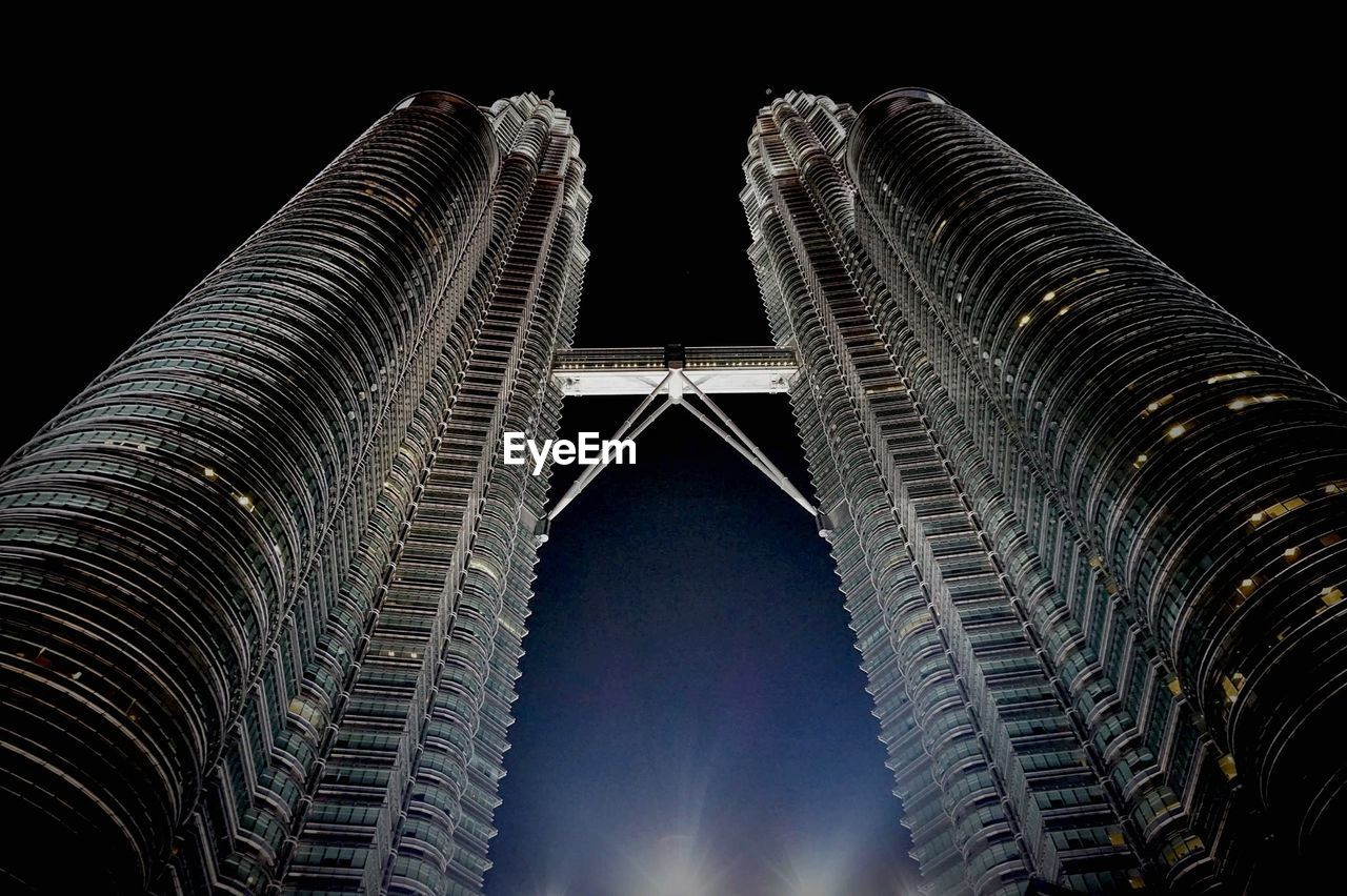 architecture, low angle view, built structure, night, illuminated, building exterior, travel destinations, outdoors, modern, no people, skyscraper, city, sky