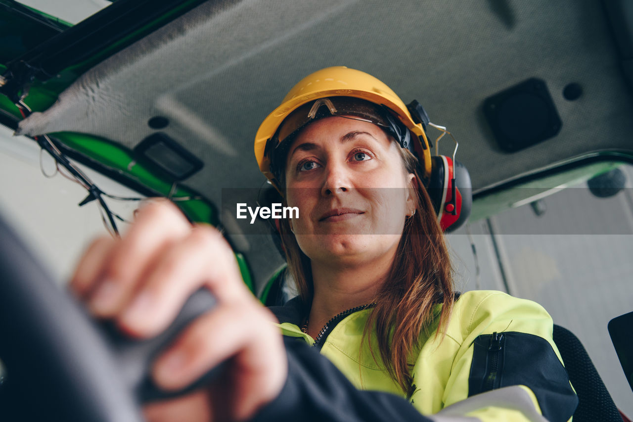 Woman Driving Construction Vehicle