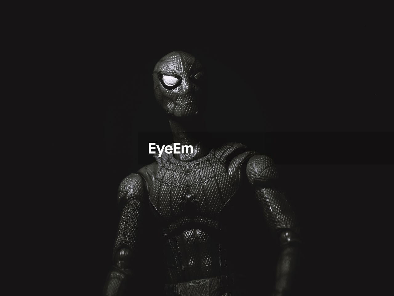 indoors, studio shot, black background, copy space, close-up, human representation, representation, no people, art and craft, creativity, dark, male likeness, sculpture, figurine, front view, statue, playing, security, aggression