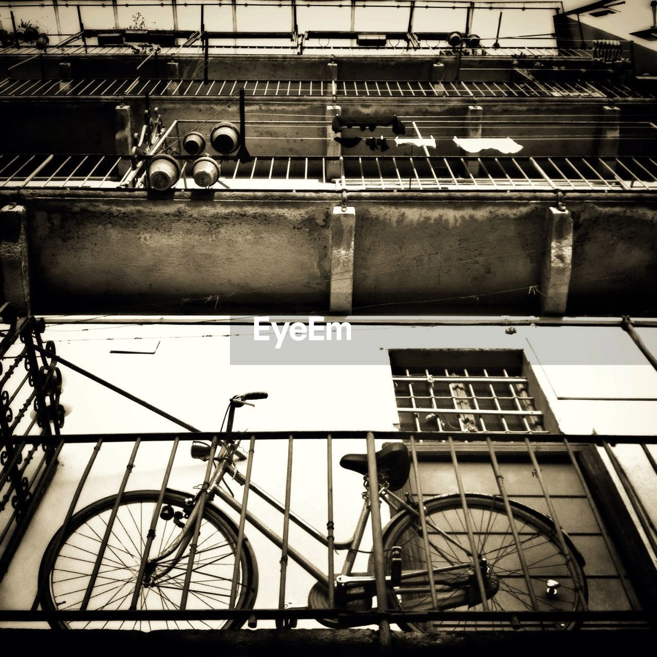 Low angle view of bicycle leaning on railing in building