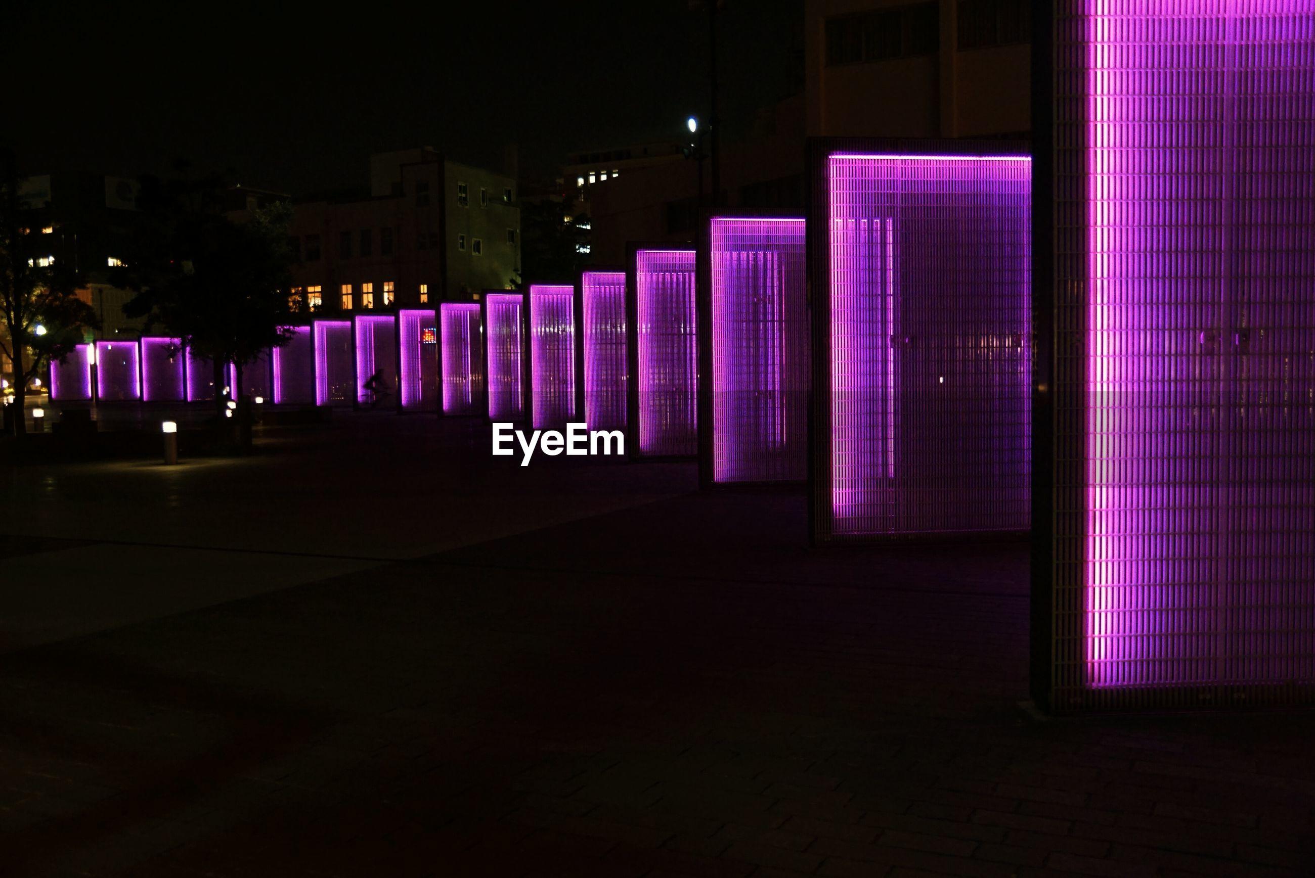 Illuminated purple panels at night