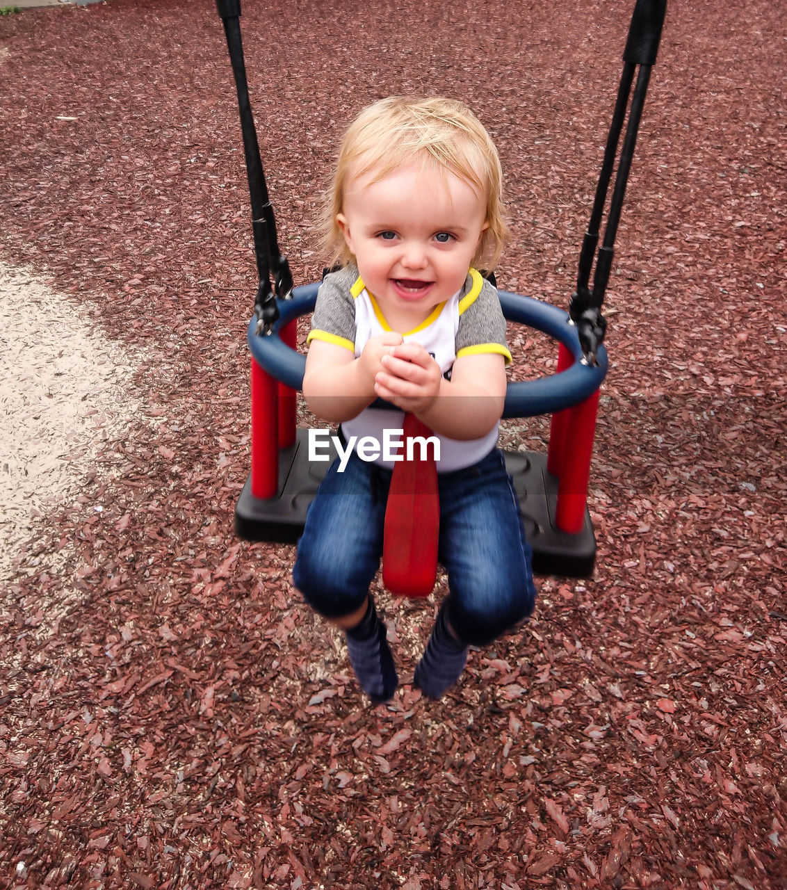 childhood, child, one person, innocence, full length, playground, real people, boys, males, front view, portrait, casual clothing, looking at camera, day, leisure activity, cute, men, playing, outdoors, outdoor play equipment