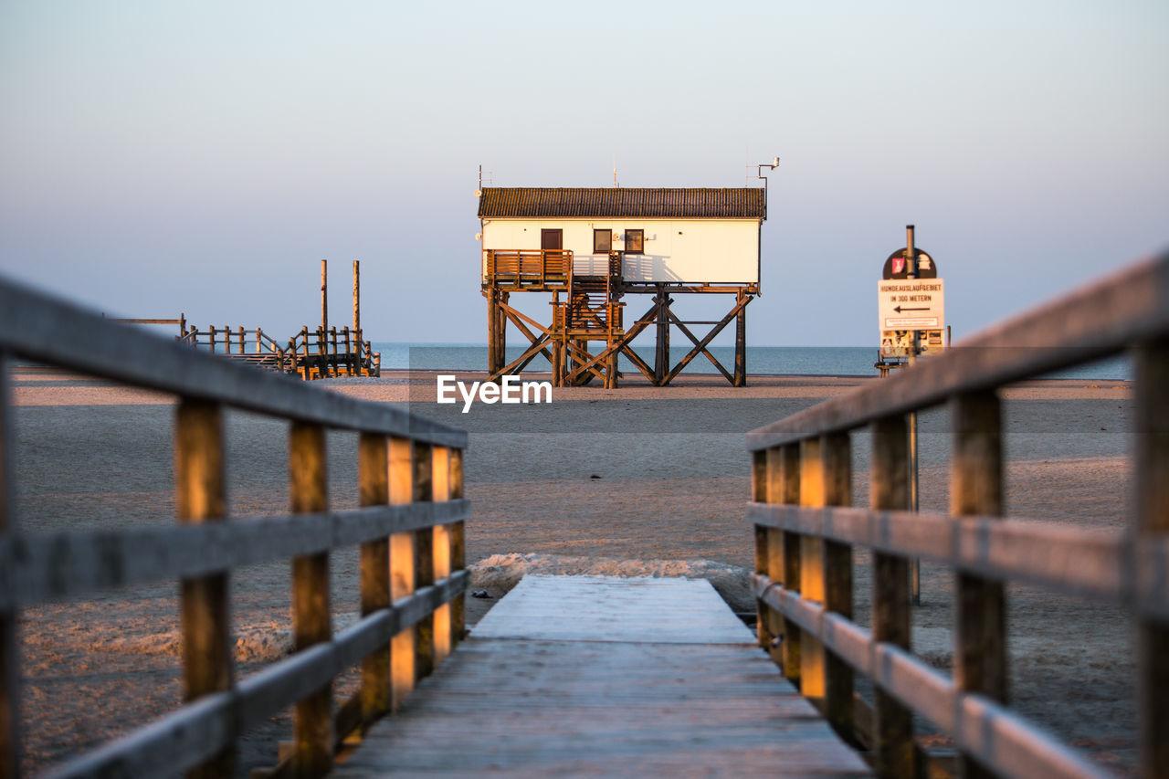 Wooden pier leading towards beach