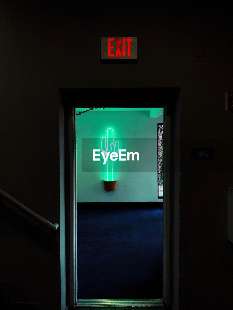 human representation, illuminated, communication, indoors, lighting equipment, guidance, symbol, no people, night