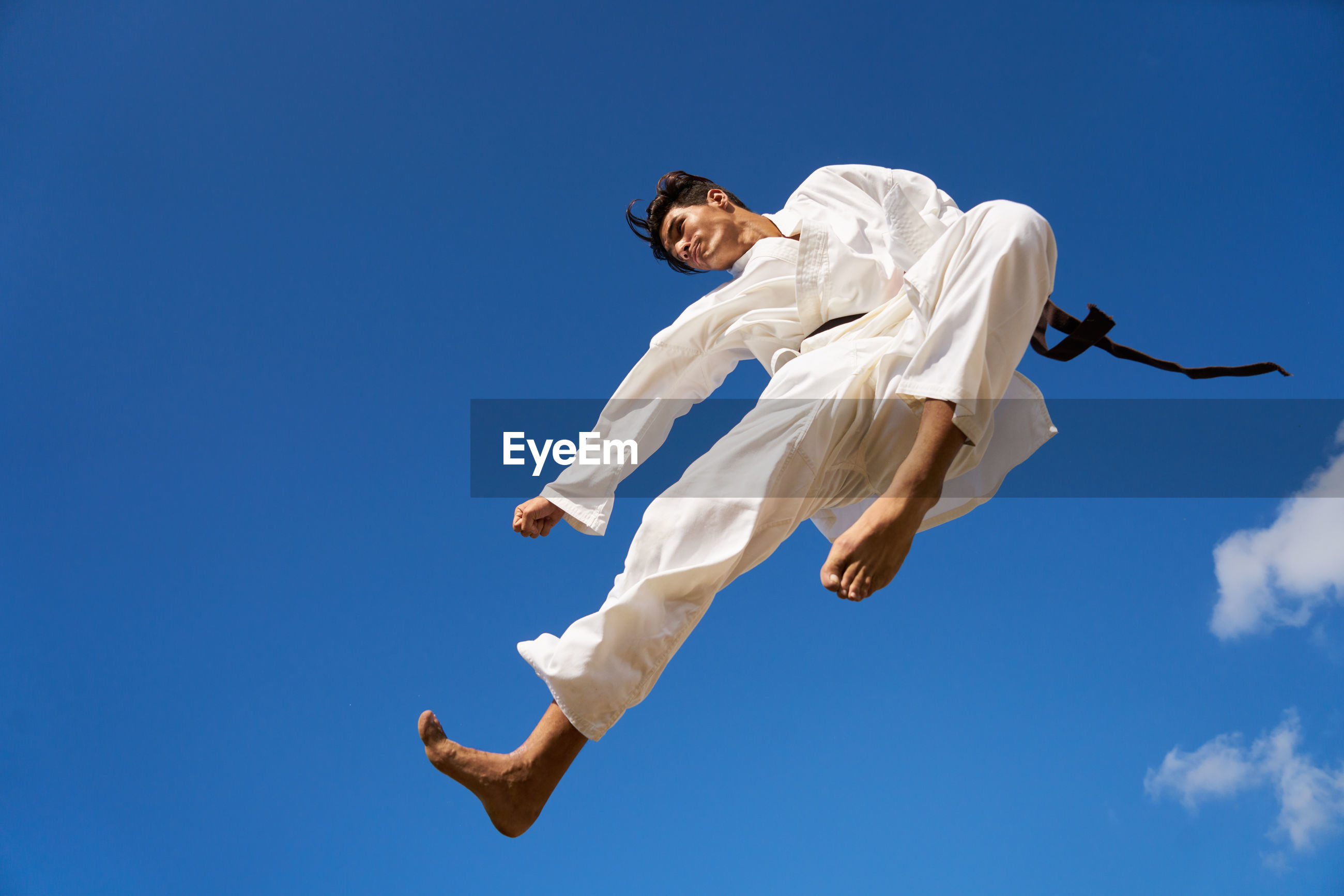 Low angle view of man practicing karate