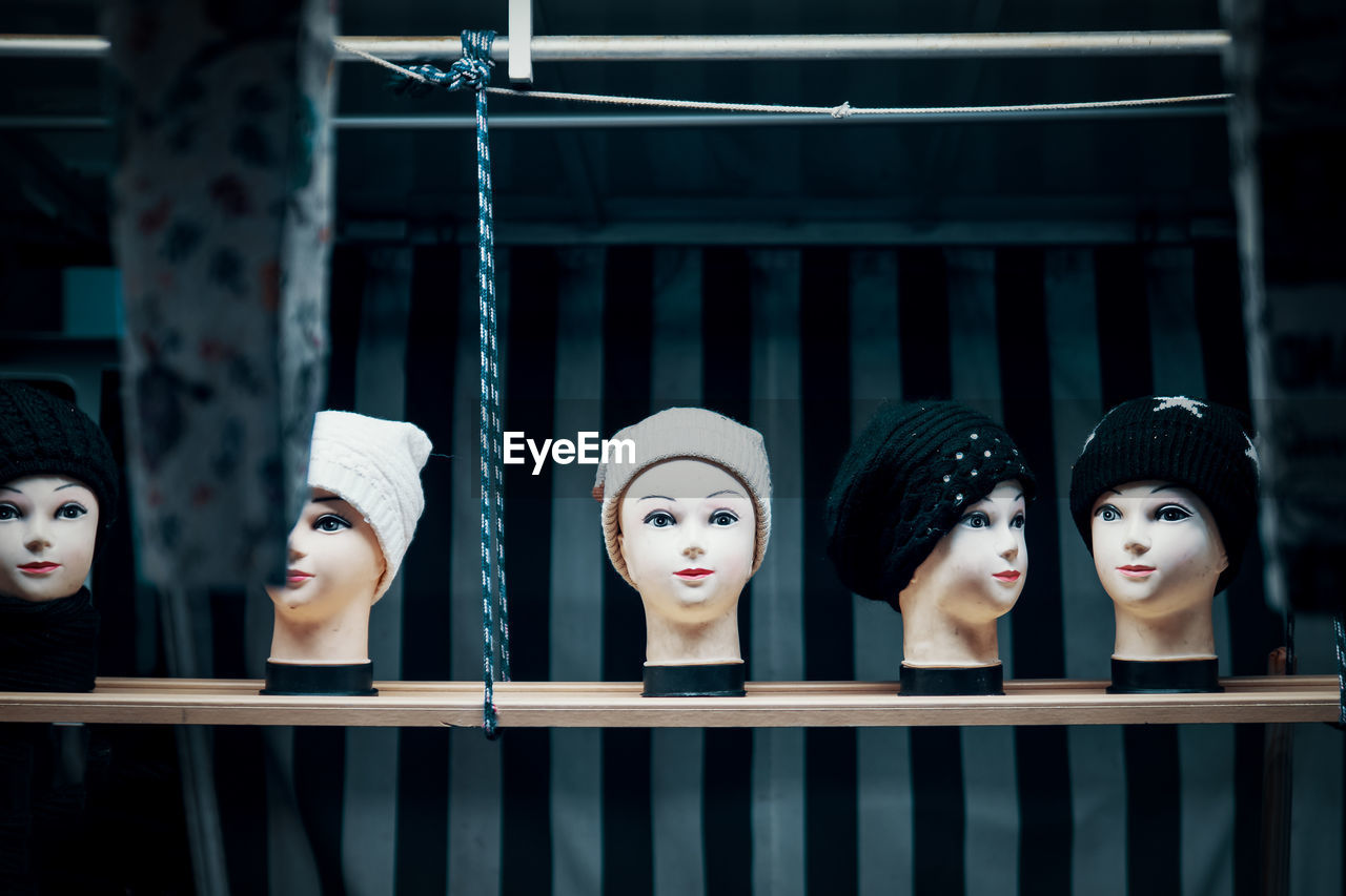 female likeness, human representation, representation, mannequin, retail, shopping, store, retail display, no people, side by side, sale, indoors, fashion, group of objects, in a row, consumerism, clothing, choice, for sale, window, boutique