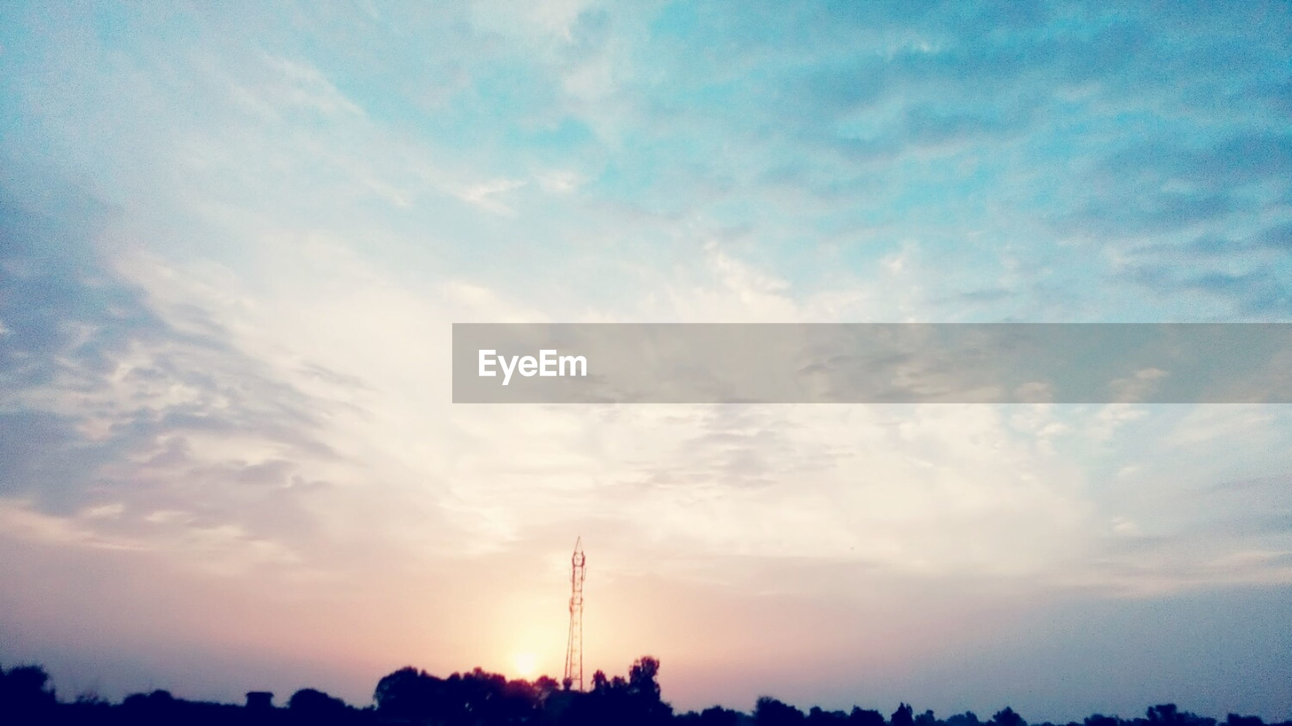 silhouette, sky, tranquility, beauty in nature, low angle view, tranquil scene, sunset, scenics, cloud - sky, nature, tree, cloud, electricity pylon, landscape, blue, idyllic, power line, outdoors, cloudy, no people