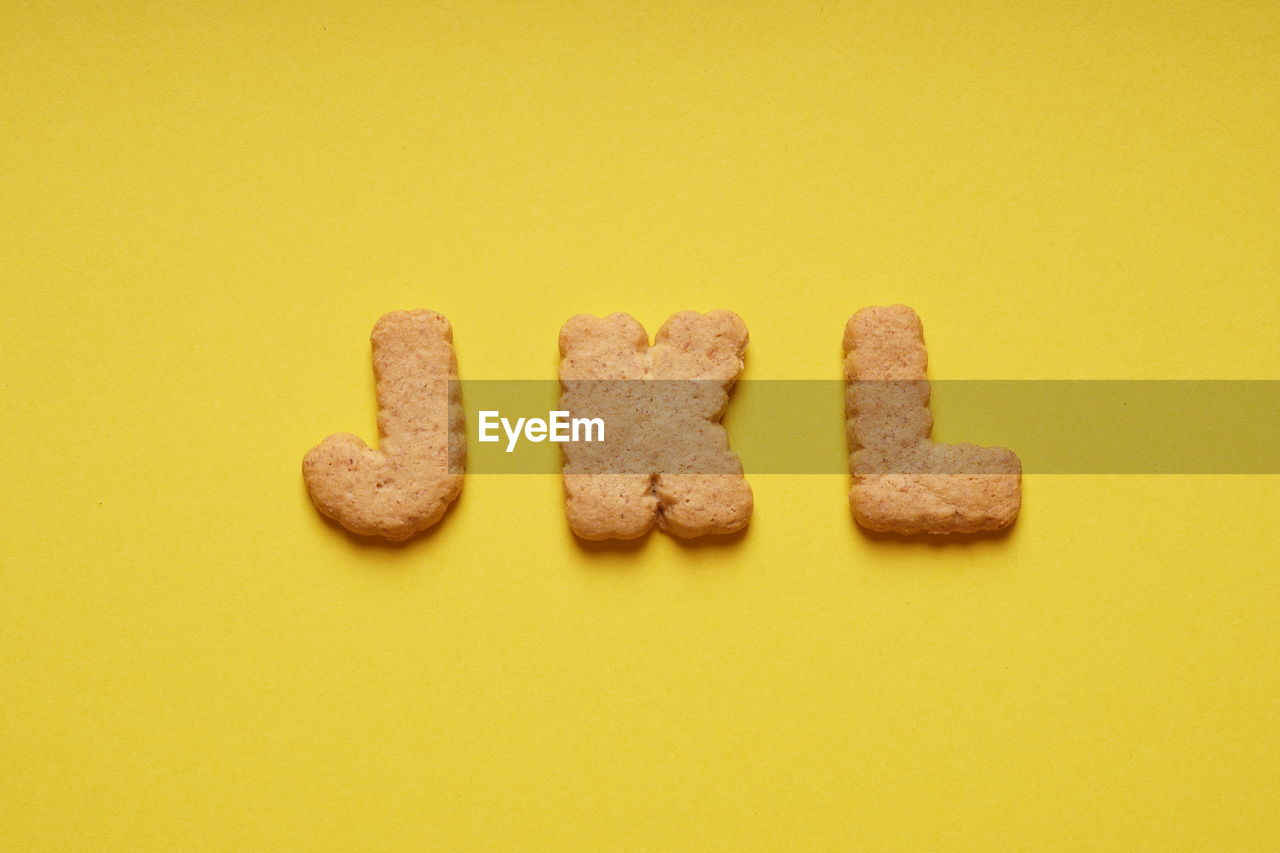 Cookies letters on yellow background