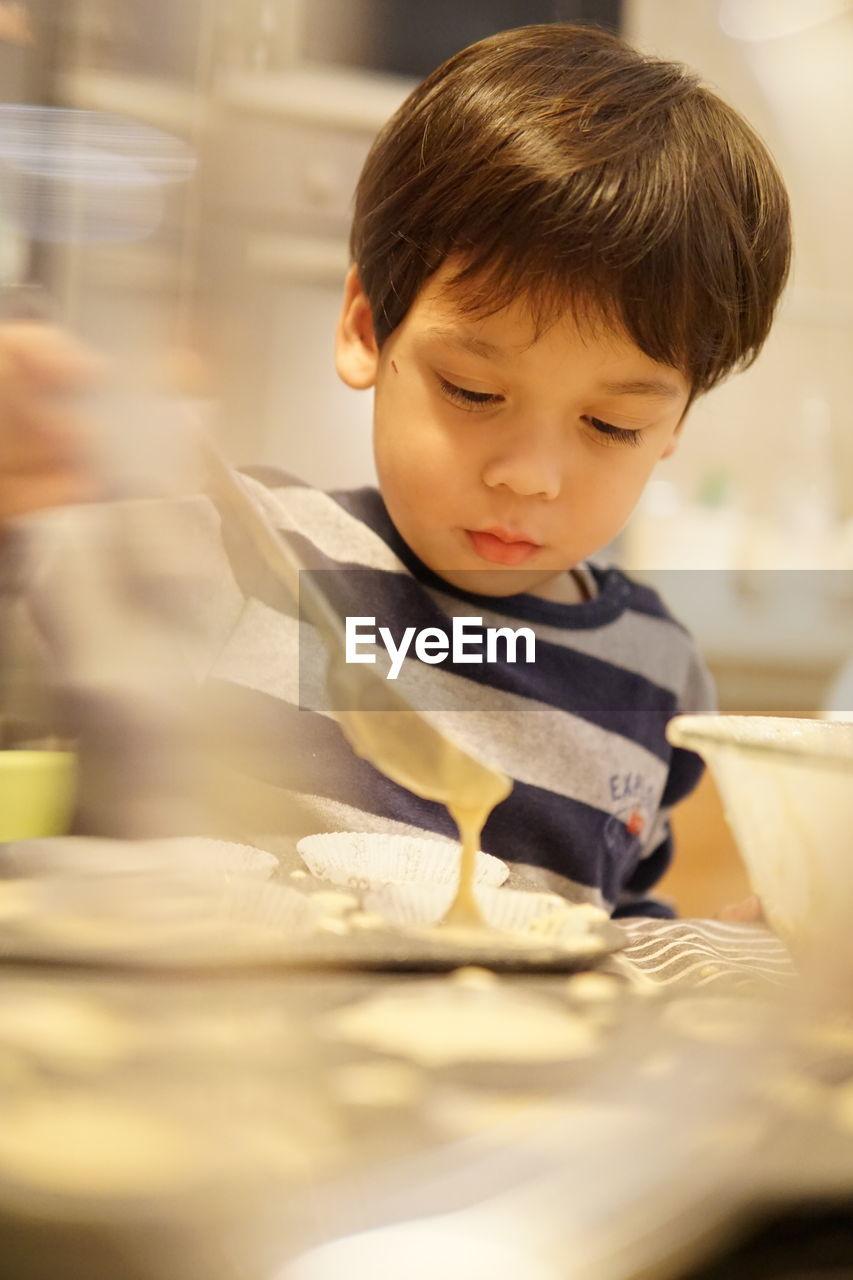 Cute boy making food