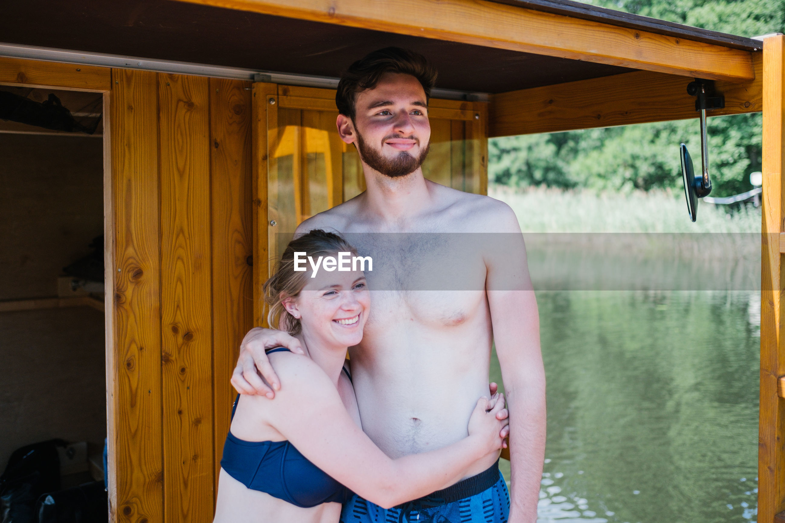 two people, real people, togetherness, emotion, young men, men, love, leisure activity, young adult, lifestyles, smiling, standing, three quarter length, shirtless, couple - relationship, happiness, males, bonding, front view, positive emotion