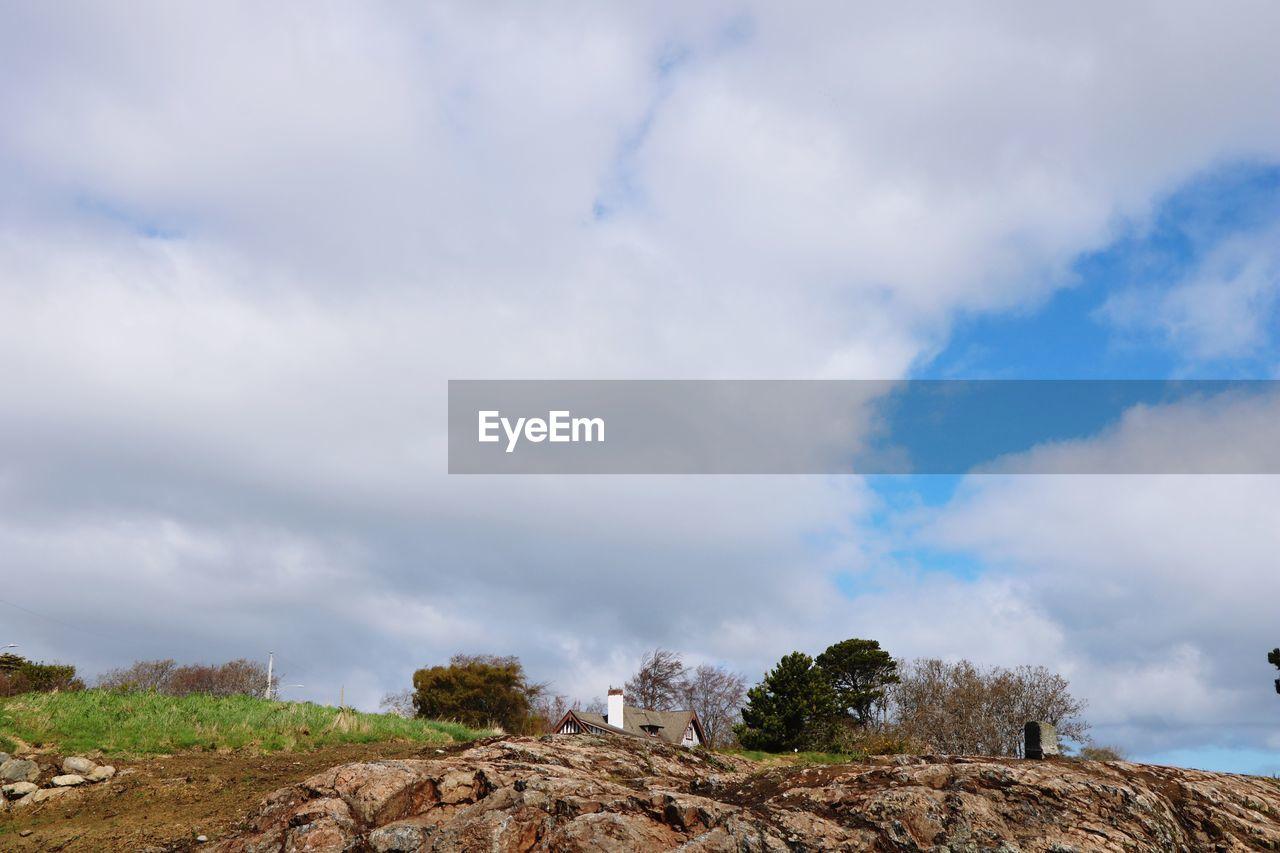 cloud - sky, sky, tranquility, scenics - nature, tranquil scene, beauty in nature, nature, rock, solid, rock - object, day, non-urban scene, no people, low angle view, environment, outdoors, tree, land, landscape, mountain