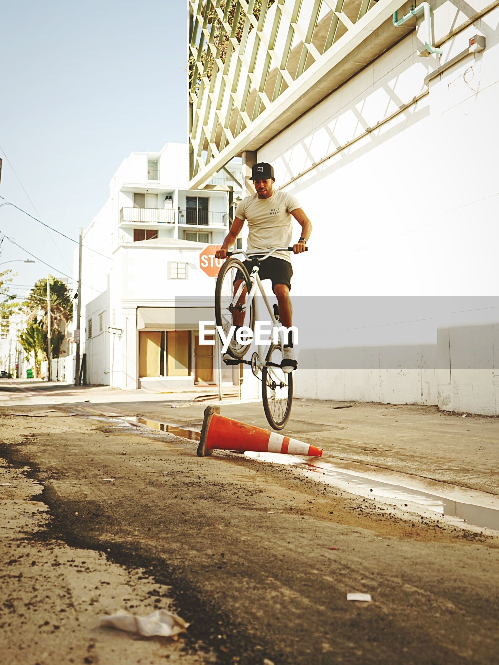 MAN RIDING BICYCLE ON CITY