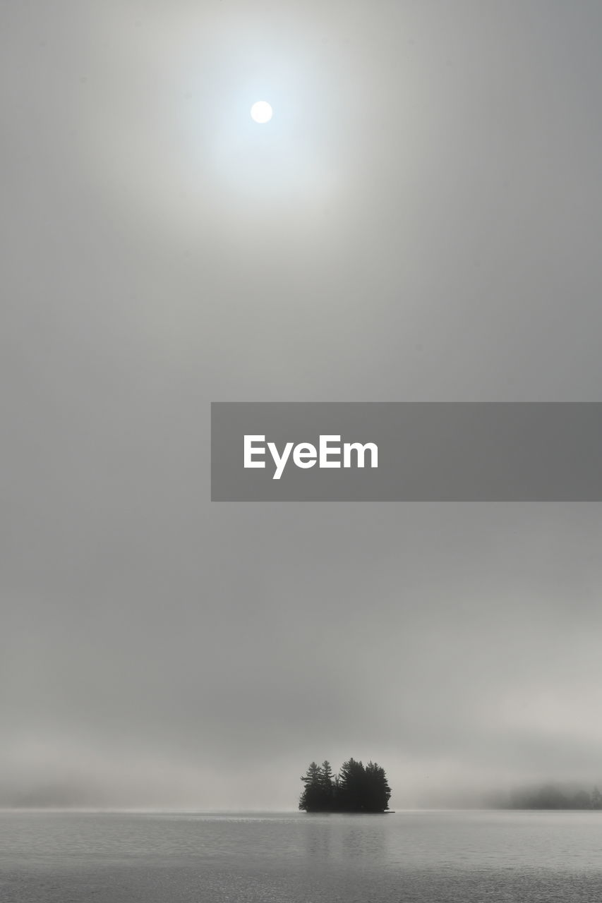 SCENIC VIEW OF SEA AGAINST SKY DURING FOG