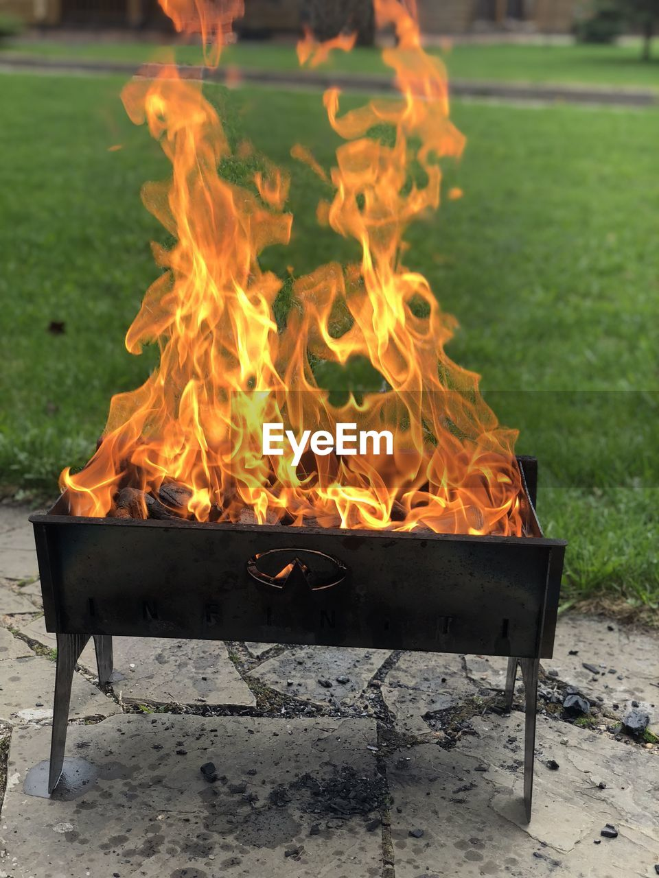 heat - temperature, fire, burning, flame, fire - natural phenomenon, nature, orange color, no people, outdoors, glowing, motion, environment, focus on foreground, wood, barbecue, wood - material, land, fire pit, front or back yard, day