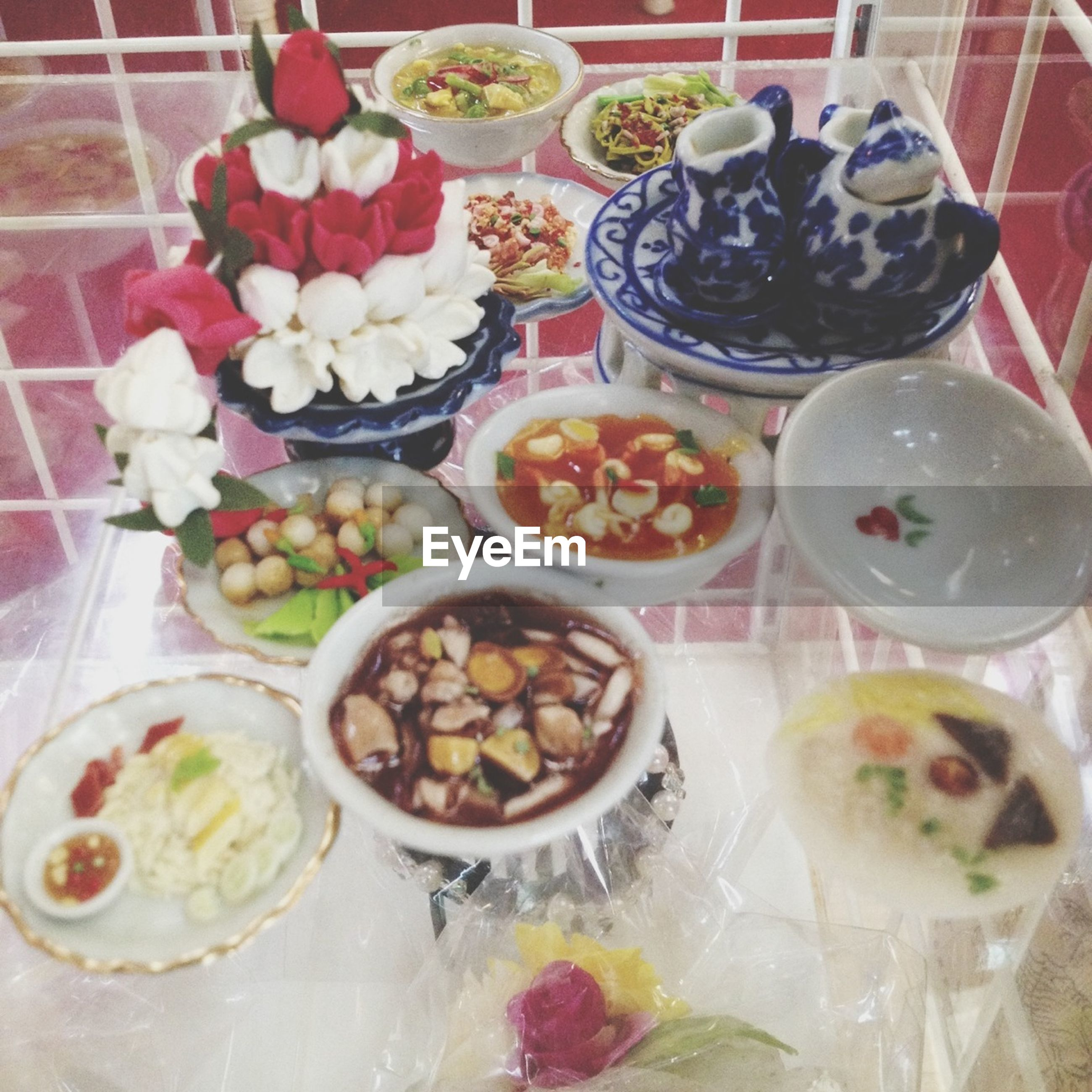 food and drink, food, indoors, freshness, still life, variation, plate, ready-to-eat, high angle view, table, healthy eating, choice, indulgence, sweet food, bowl, abundance, large group of objects, arrangement, serving size, no people