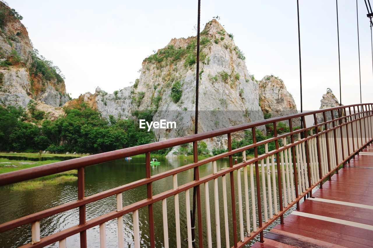 railing, sky, nature, day, tree, bridge, connection, mountain, plant, no people, beauty in nature, transportation, rock, tranquility, architecture, outdoors, bridge - man made structure, clear sky, metal, scenics - nature, footbridge