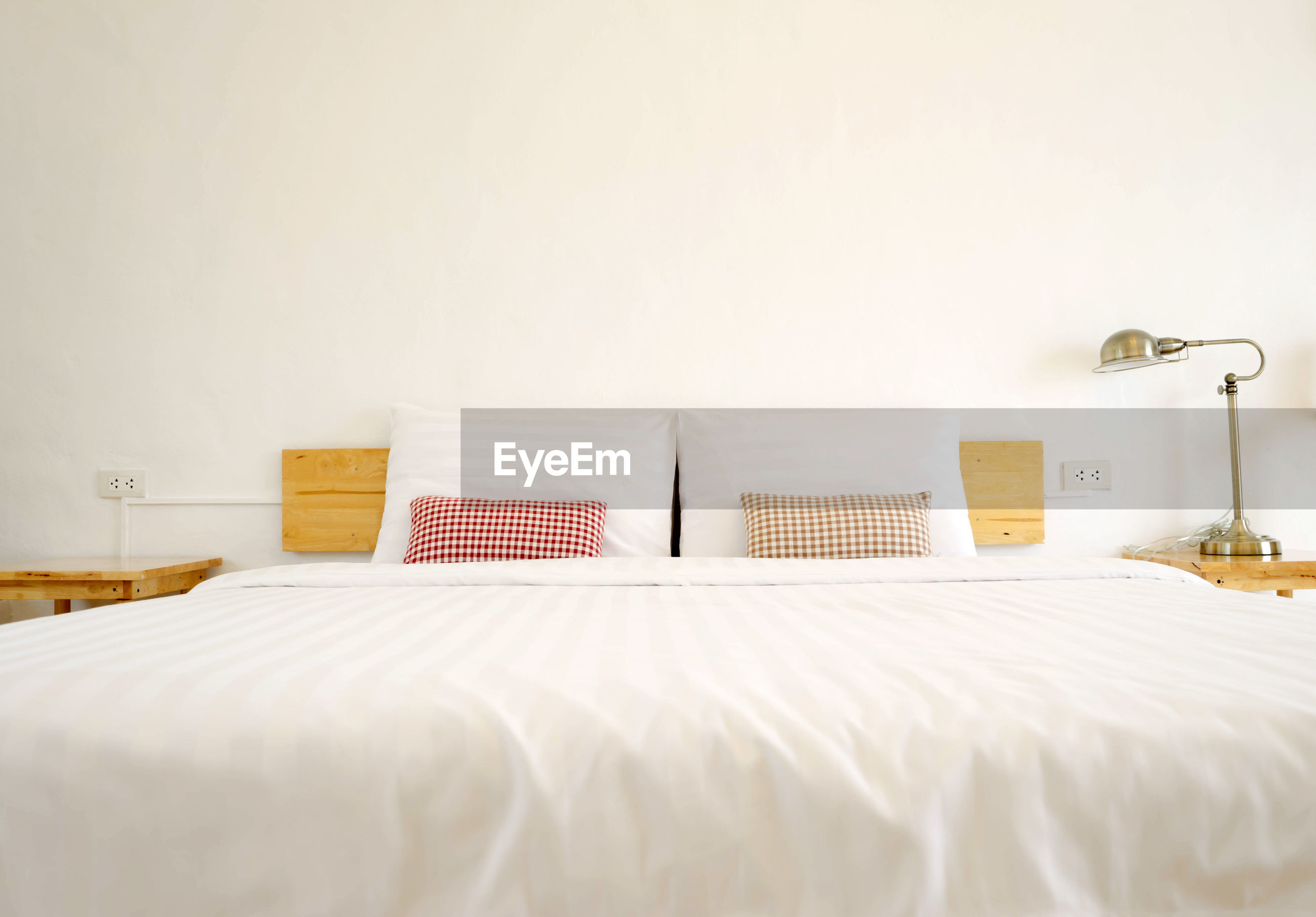 Bed against wall at home